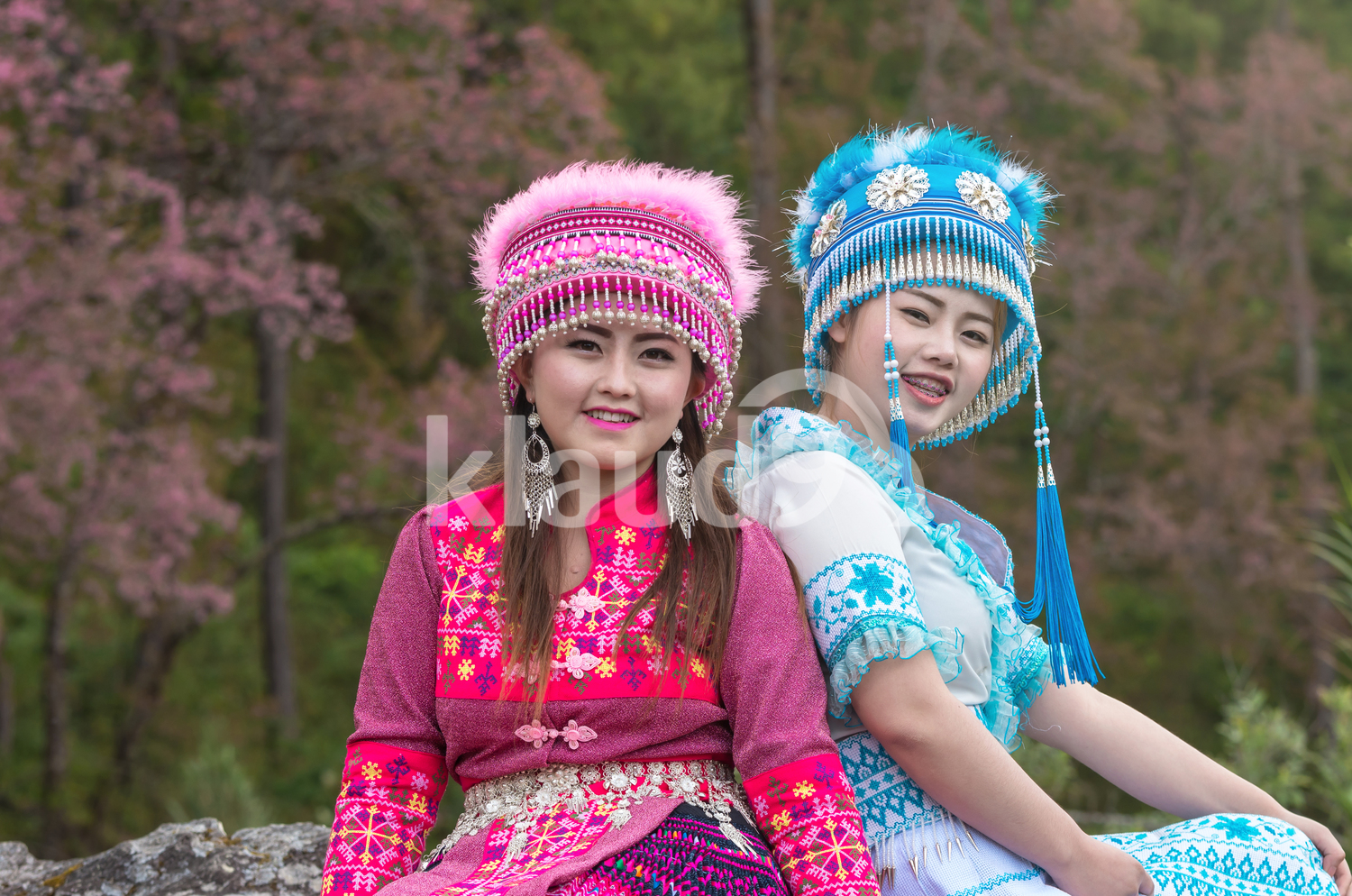 Portrait of two smiling Hmong ladies