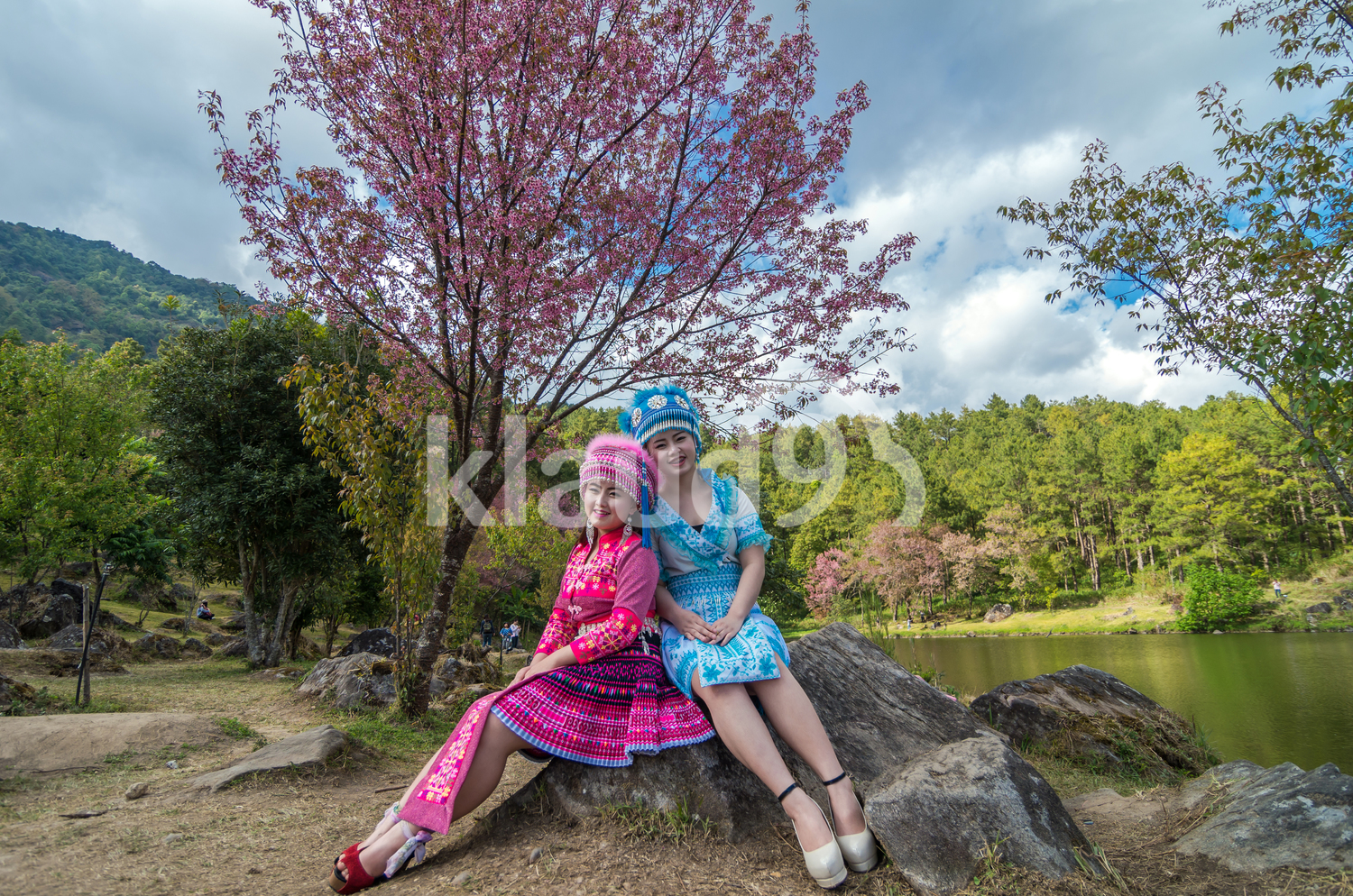 Portrait of Two Hmong girls with traditional costume
