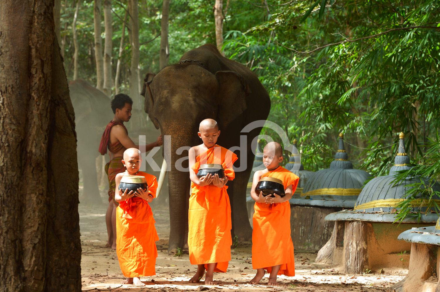 Monks going around for Alms