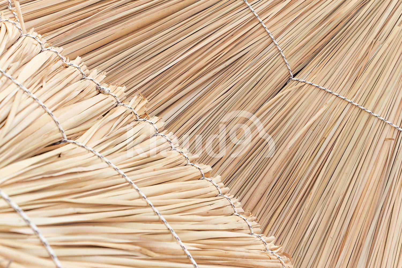 Wicker straw umbrellas closeup