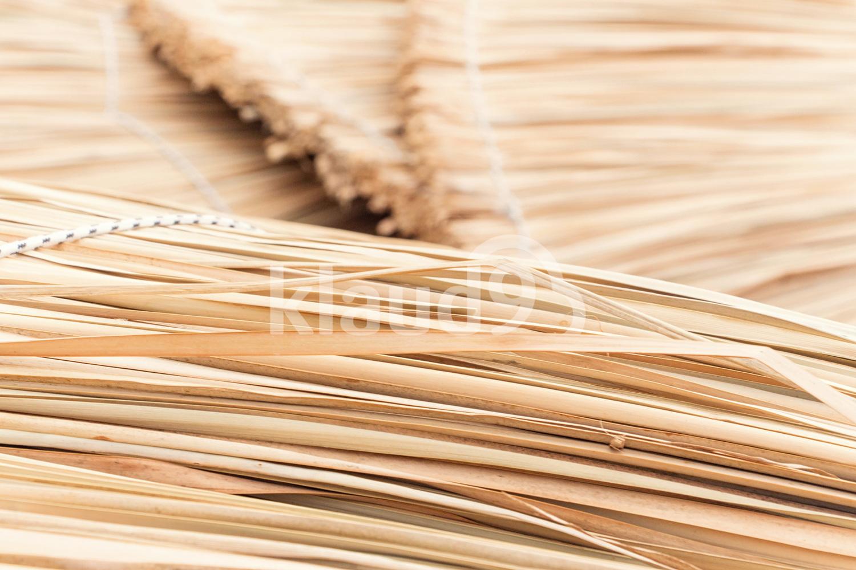Wicker straw umbrellas closeup background