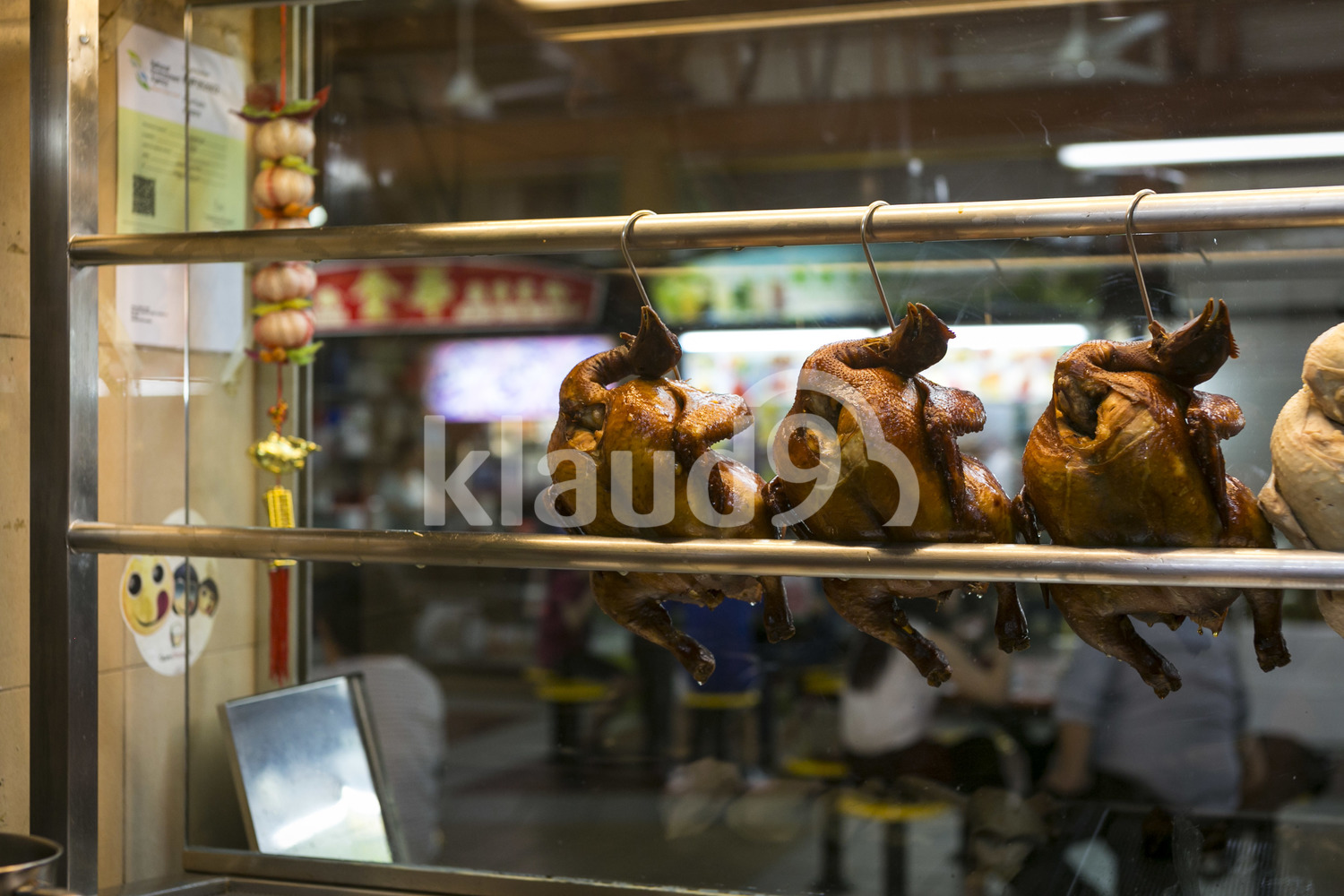 Skewed chickens in a hawker