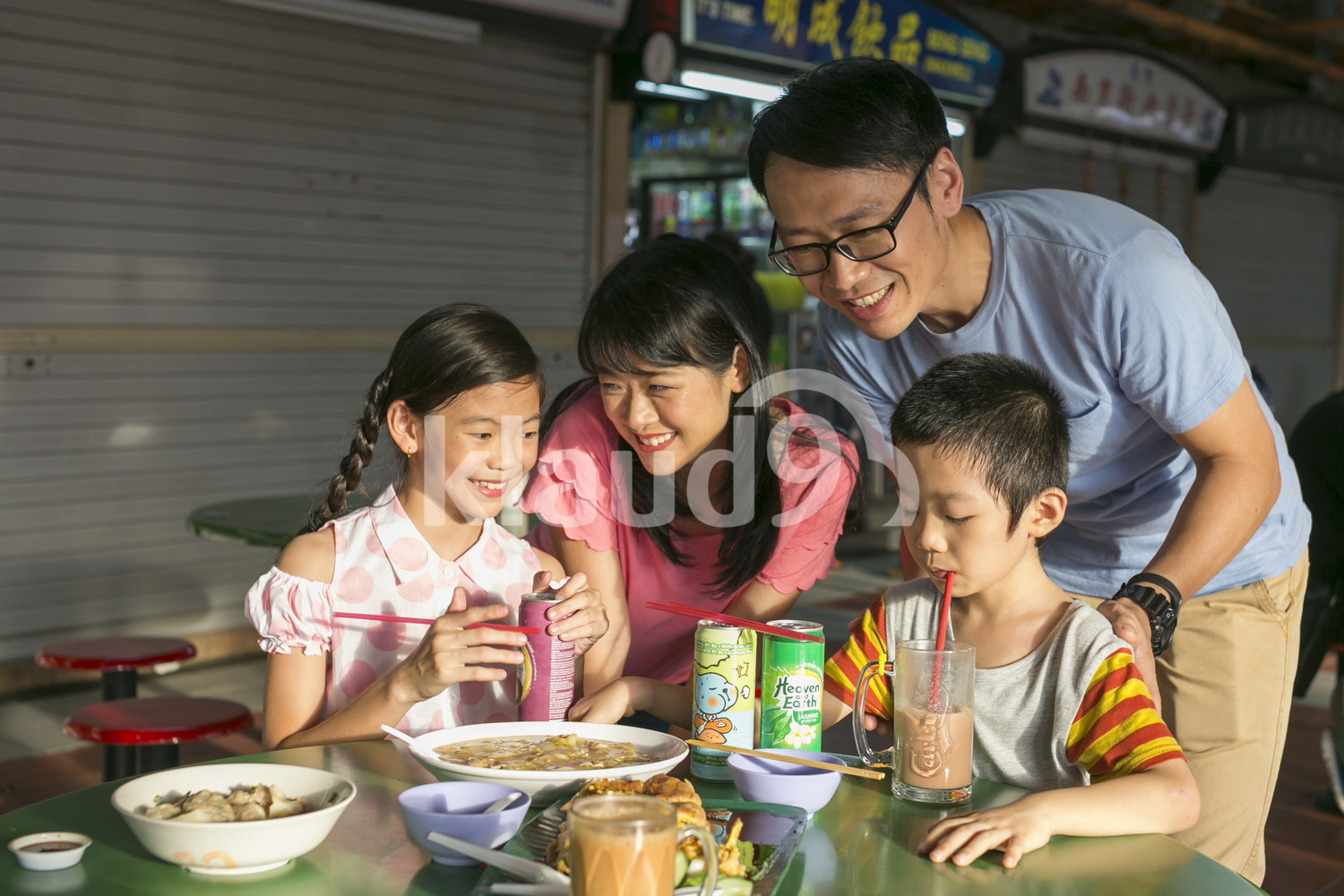 Family of four having a meal in a hawker centre