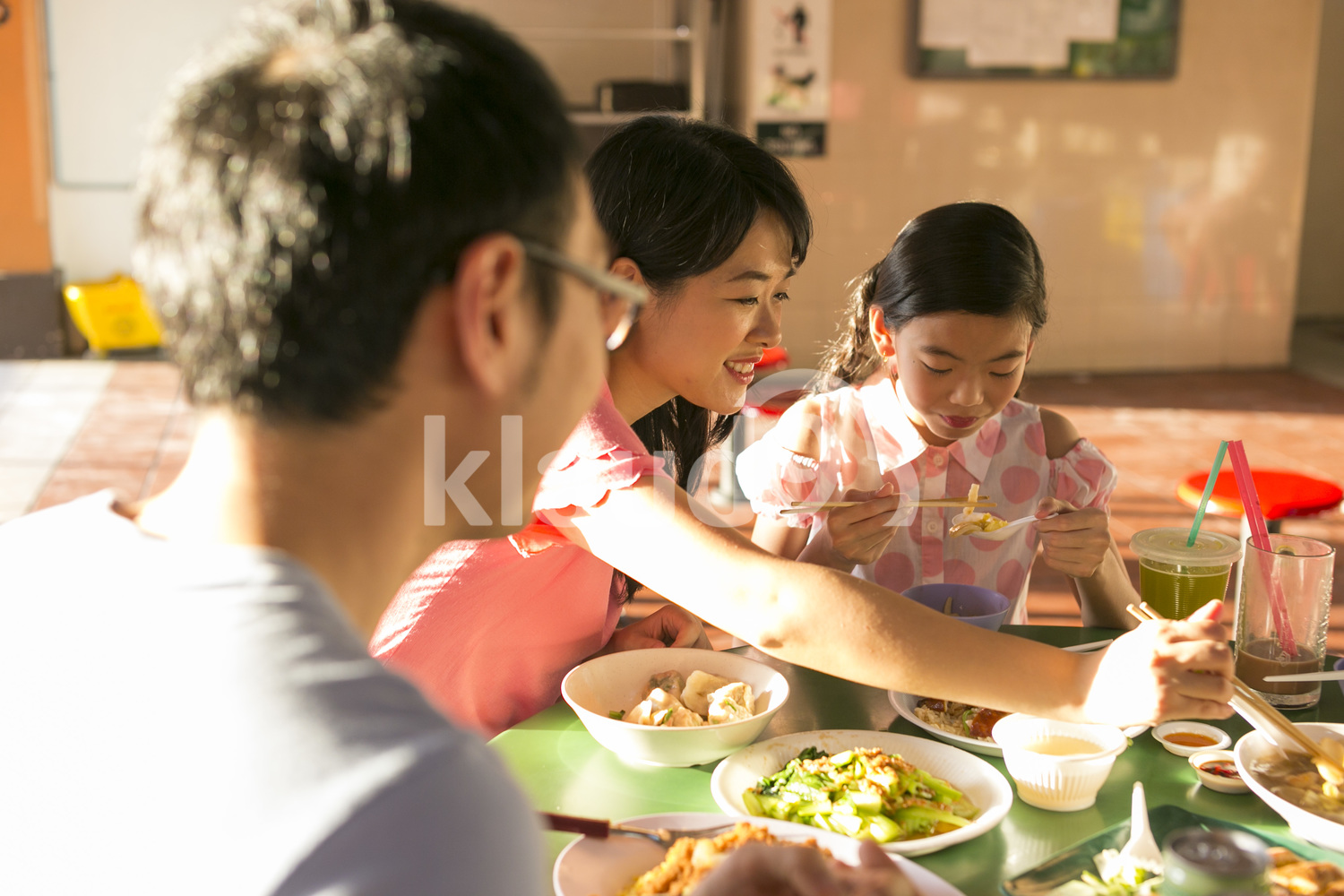 Family eating in a hawker center