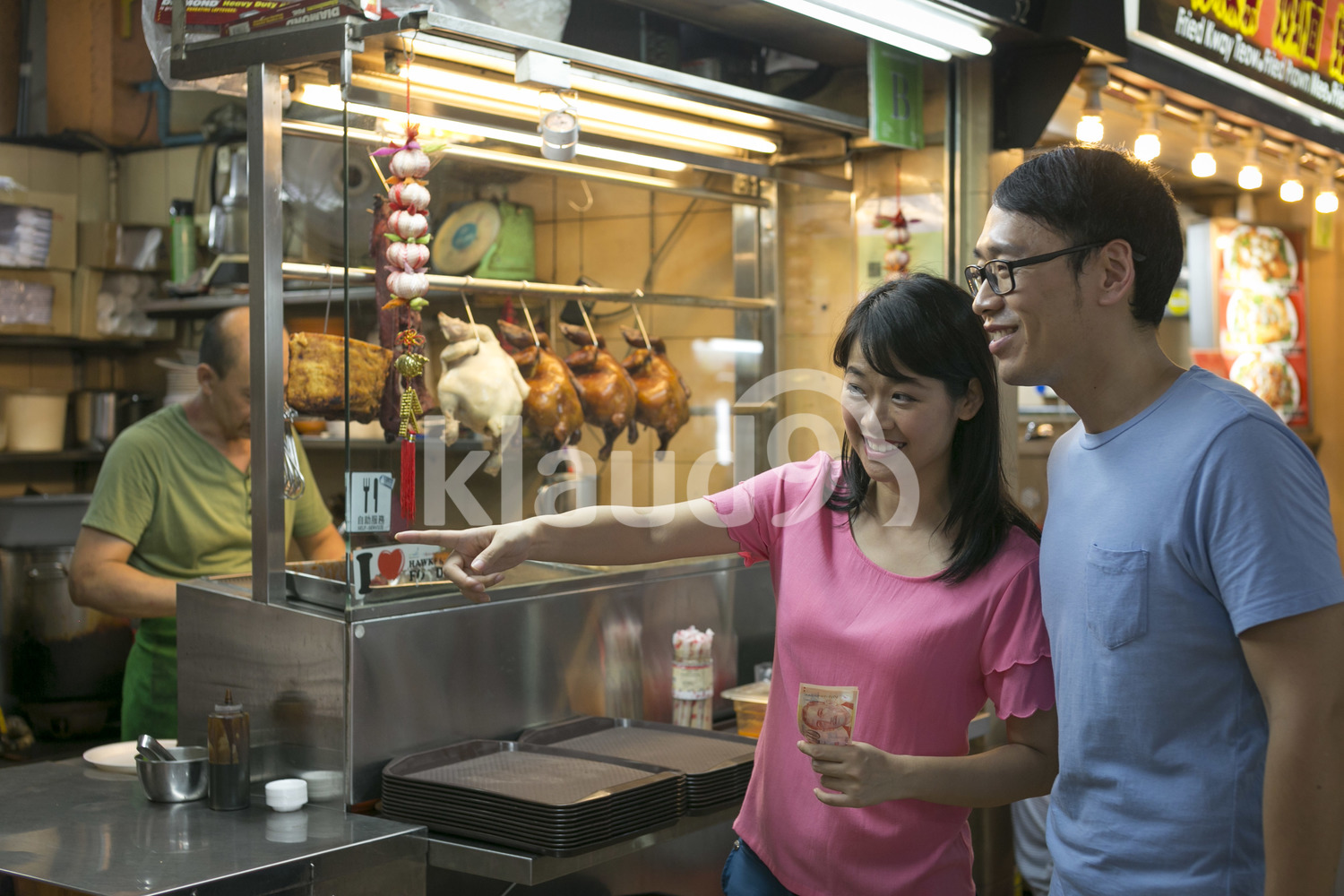 Couple ordering at Maxwell Hawker Centre