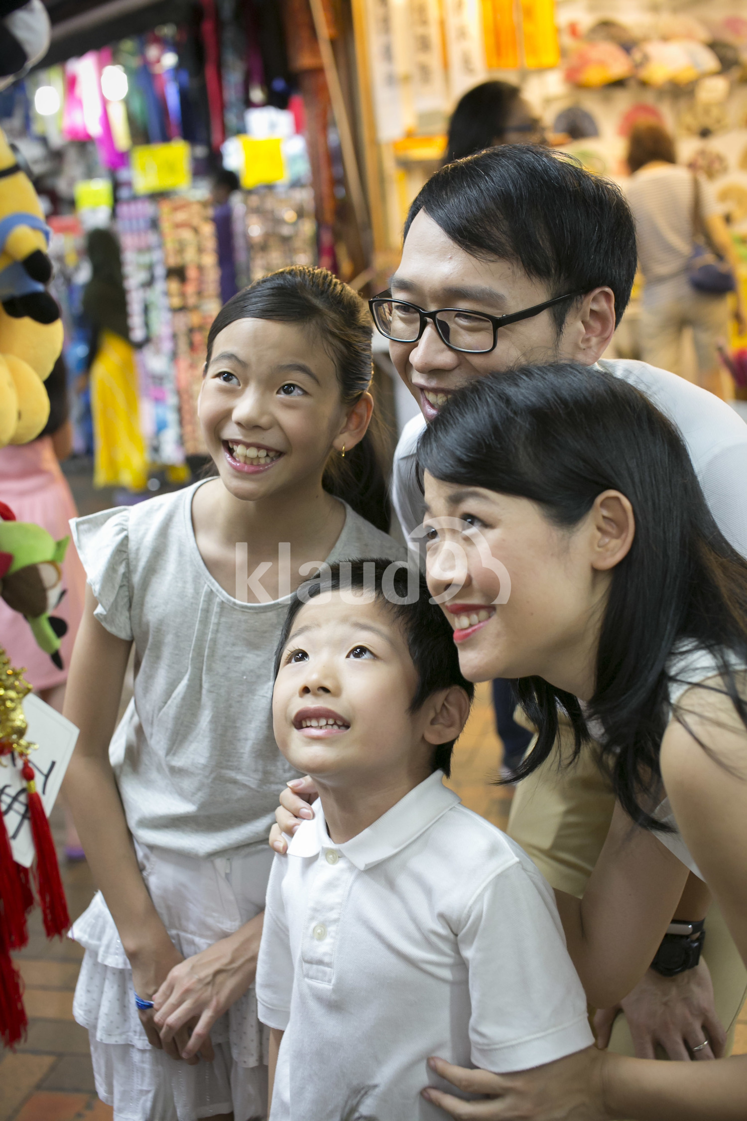 Family of four shopping in Chinatown