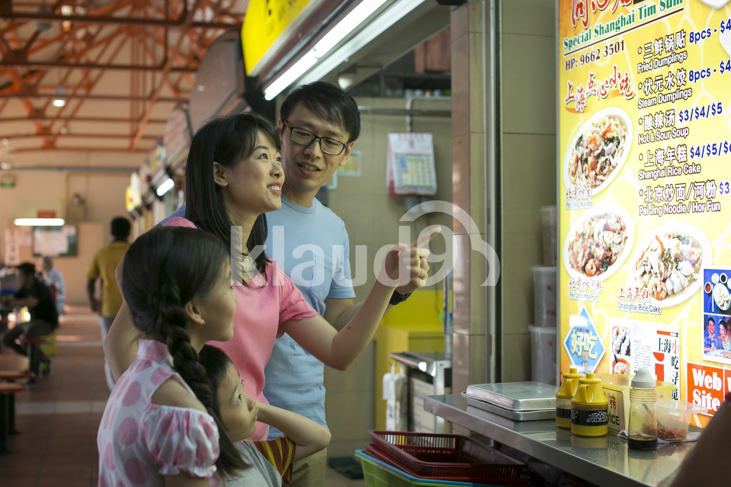 Family of four in a hawker centre