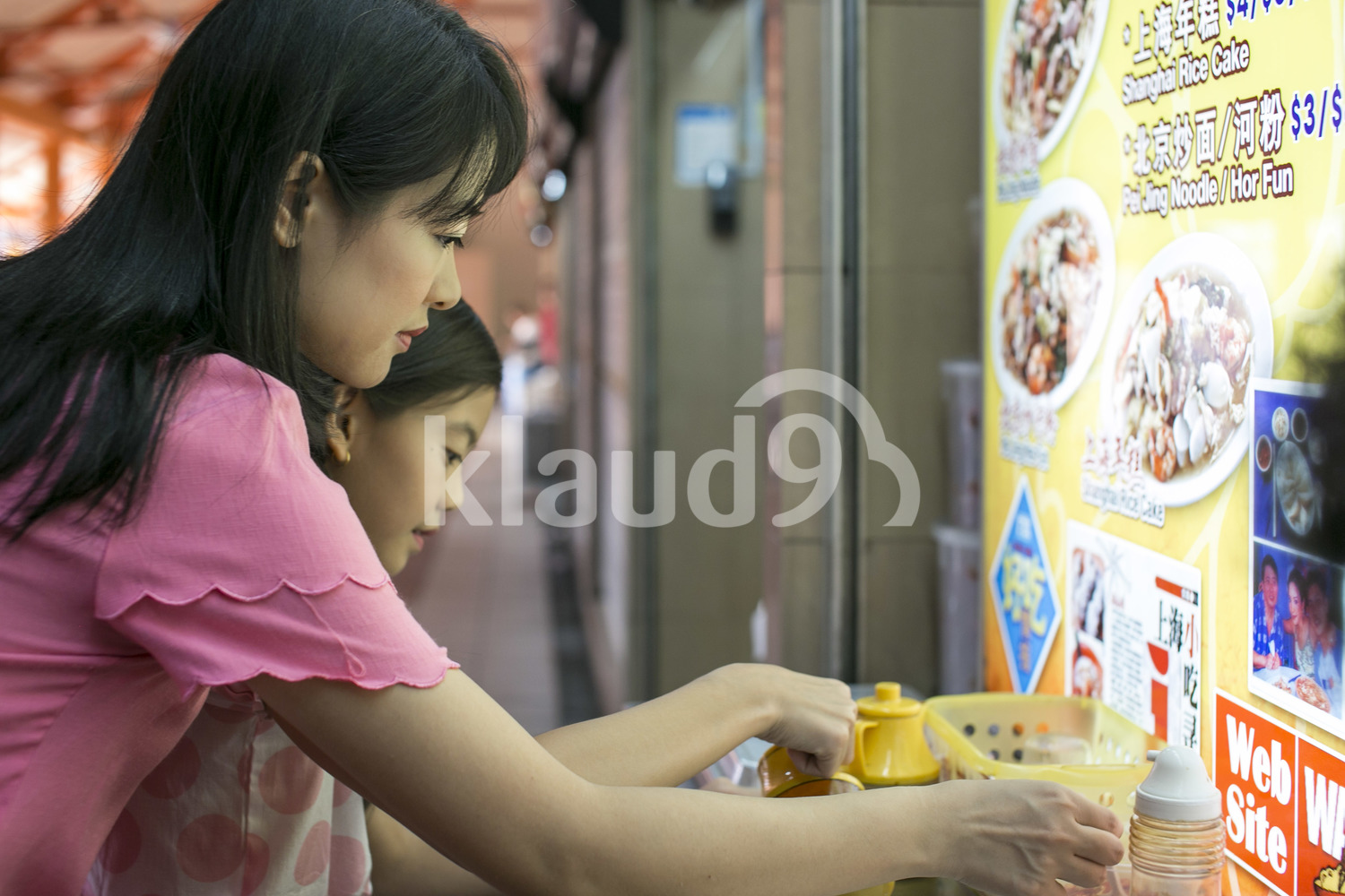 Mother and daughter in a hawker centre