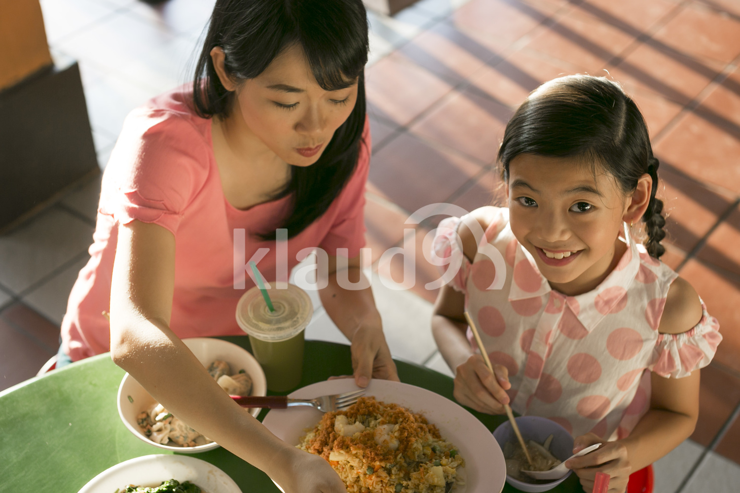 Mother and daughter enjoying street food in Singapore