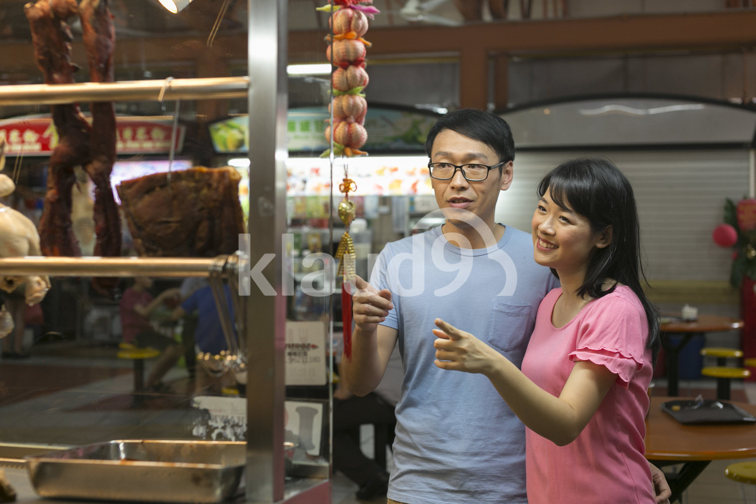 Couple choosing food at Hawker Centre