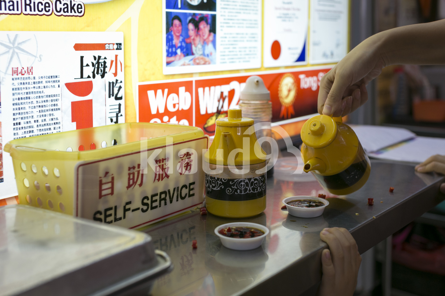 Hand pouring Chinese spices at hawker centre