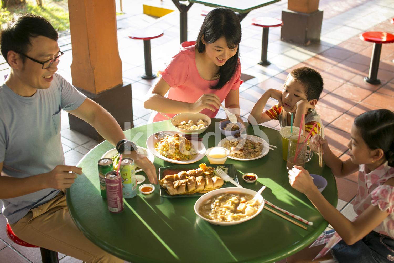 Family having dinner in a hawker center
