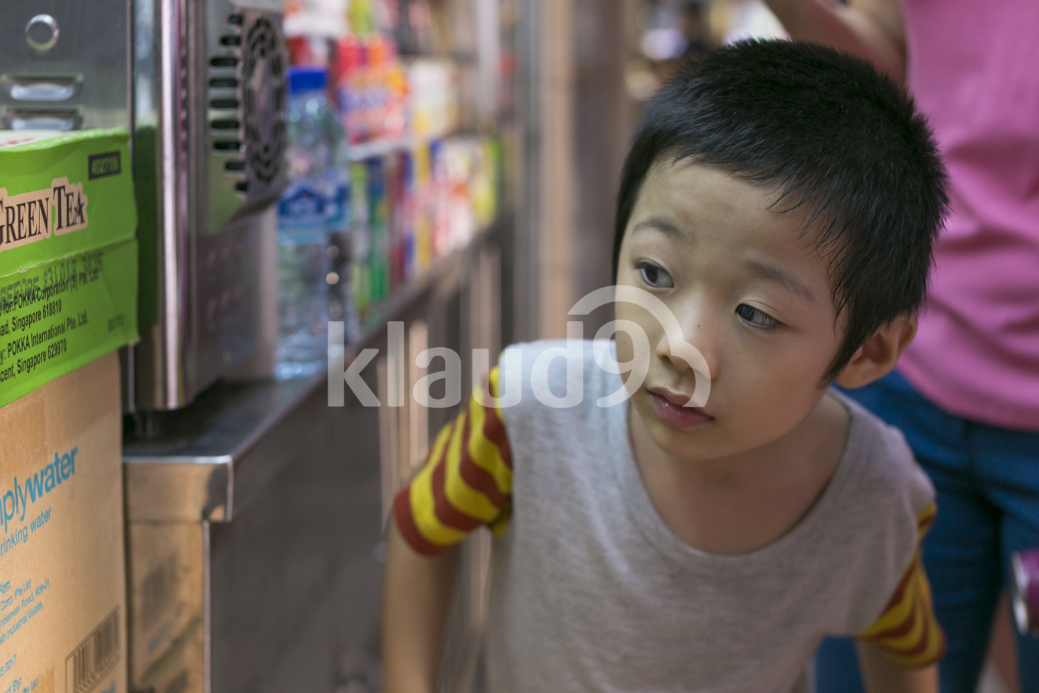 Curious little boy in a hawker centre