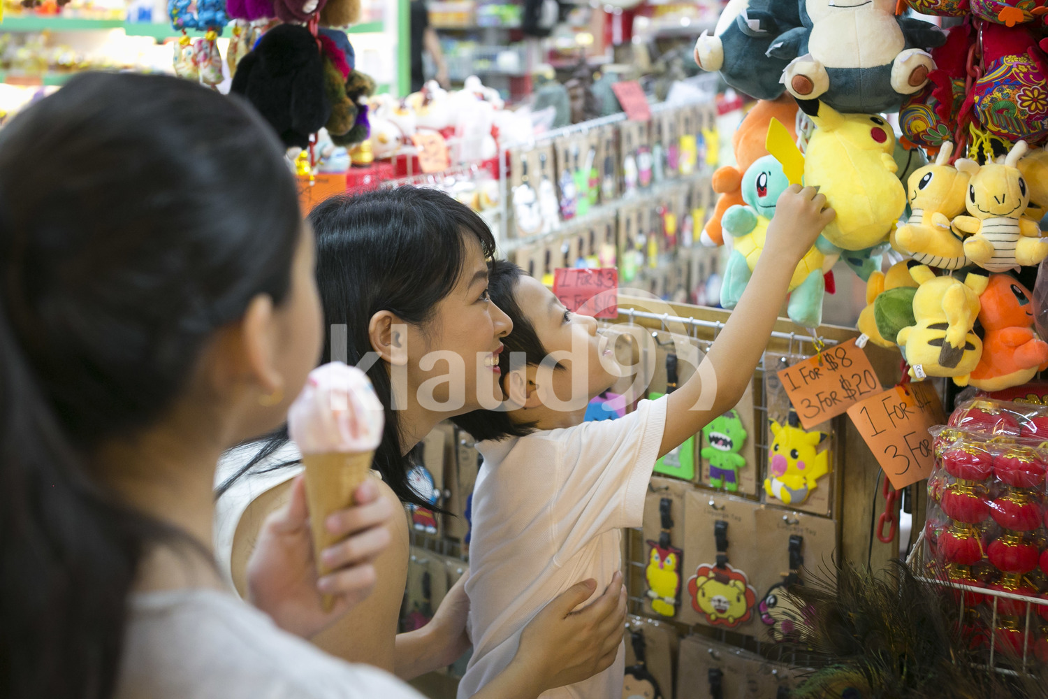 Mother shops in Chinatown with her son and her daughter