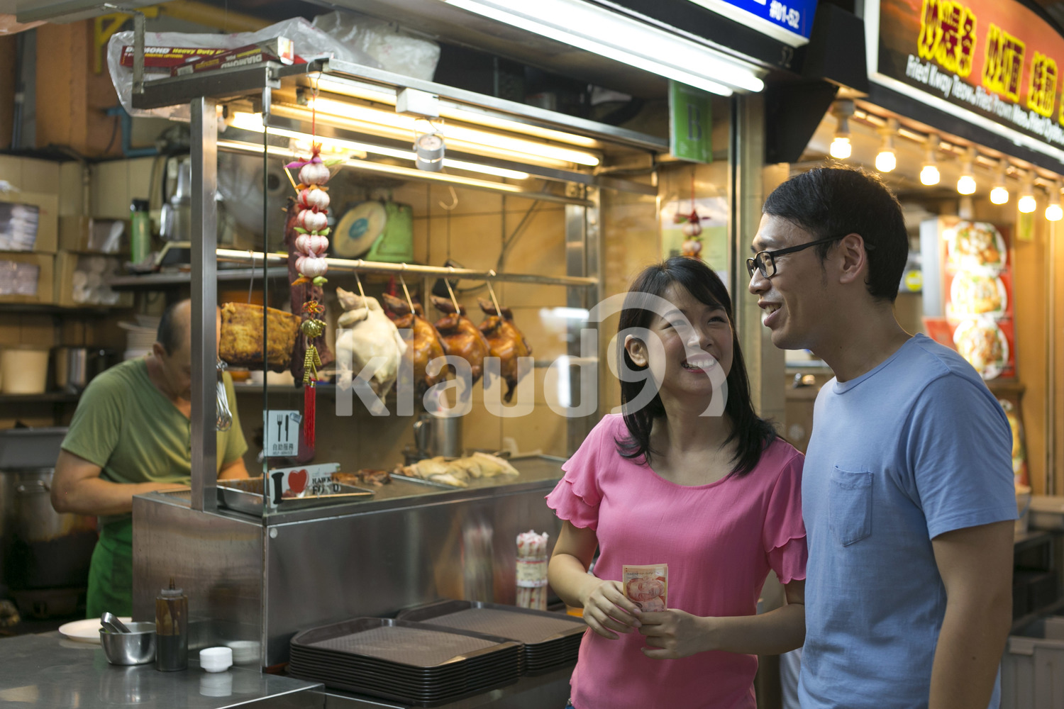 Couple ordering food at Maxwell Hawker Centre