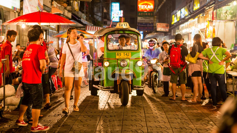 Tuk - tuk on Chinatown street at night  in Bangkok.