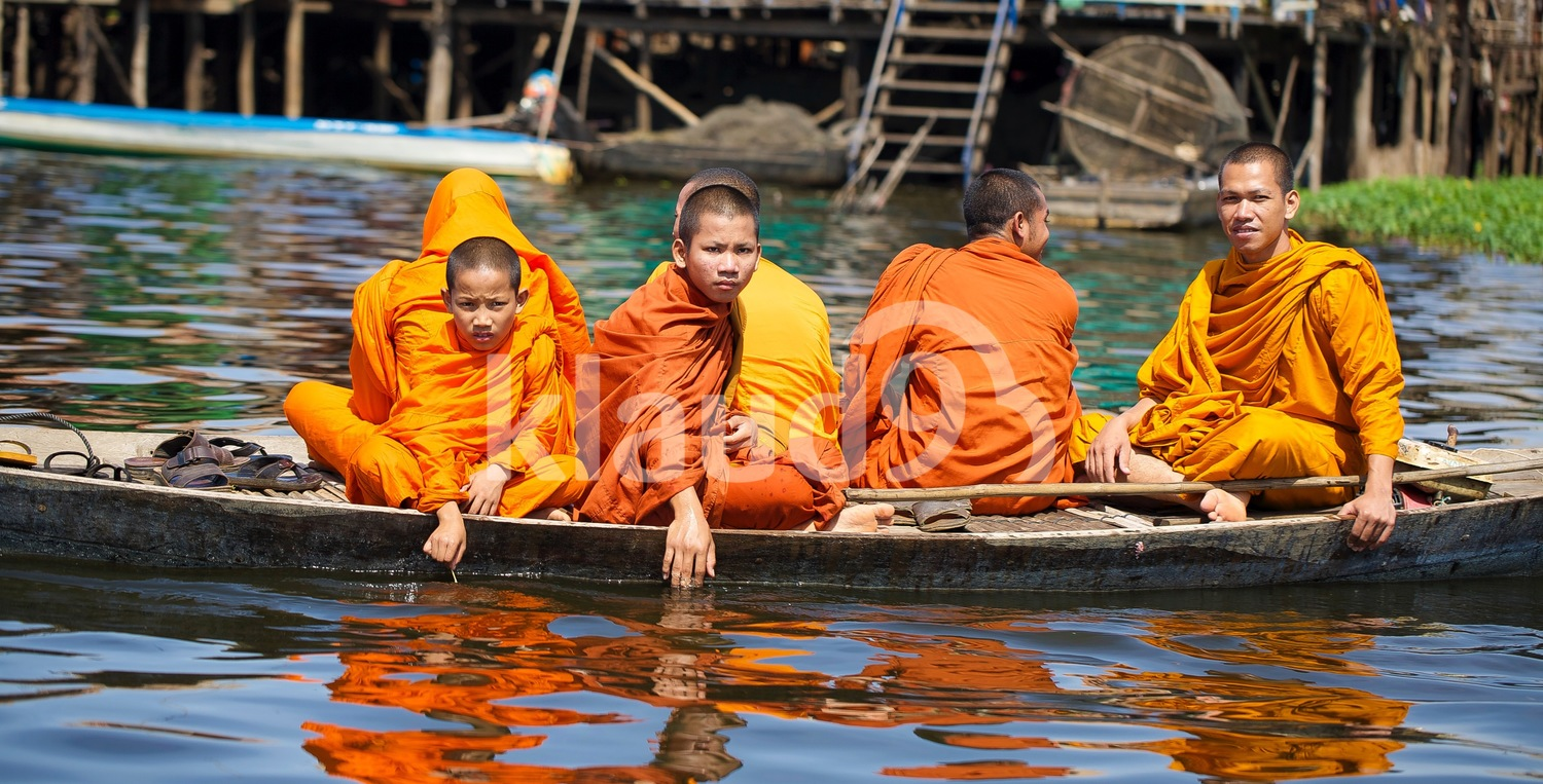 Monks on a boat; Tonle Sap, Cambodia