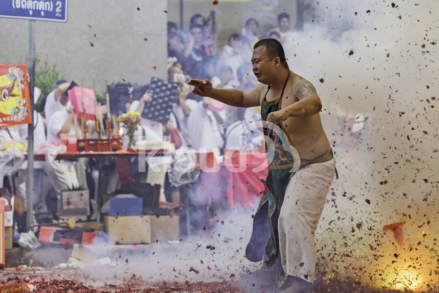 Man performing a firecracker dance