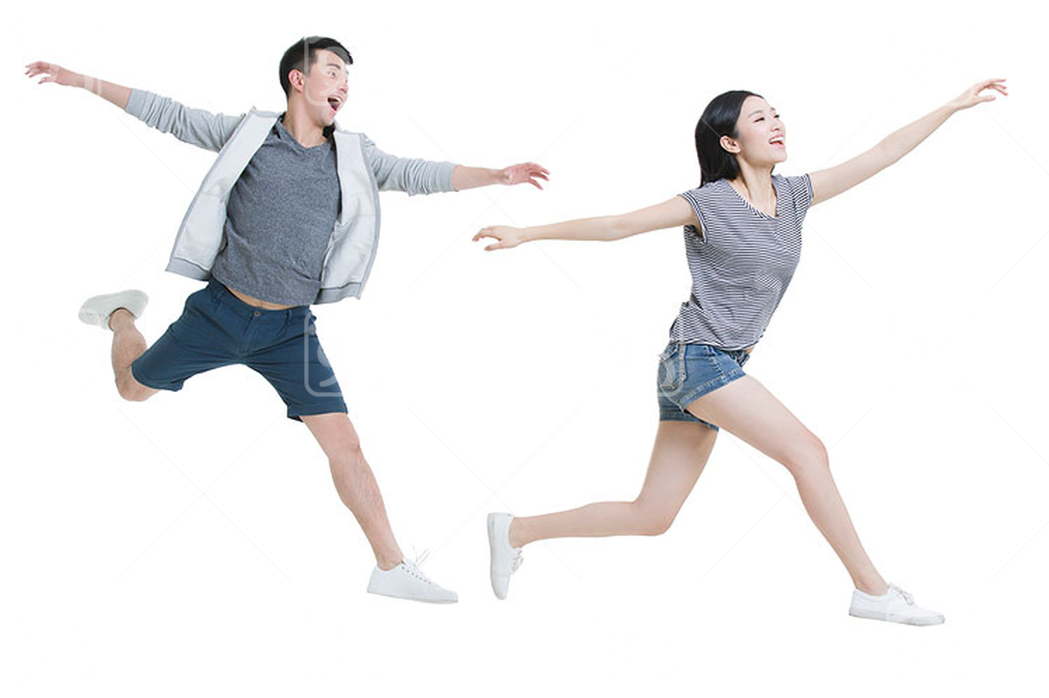 Happy young Chinese couple running