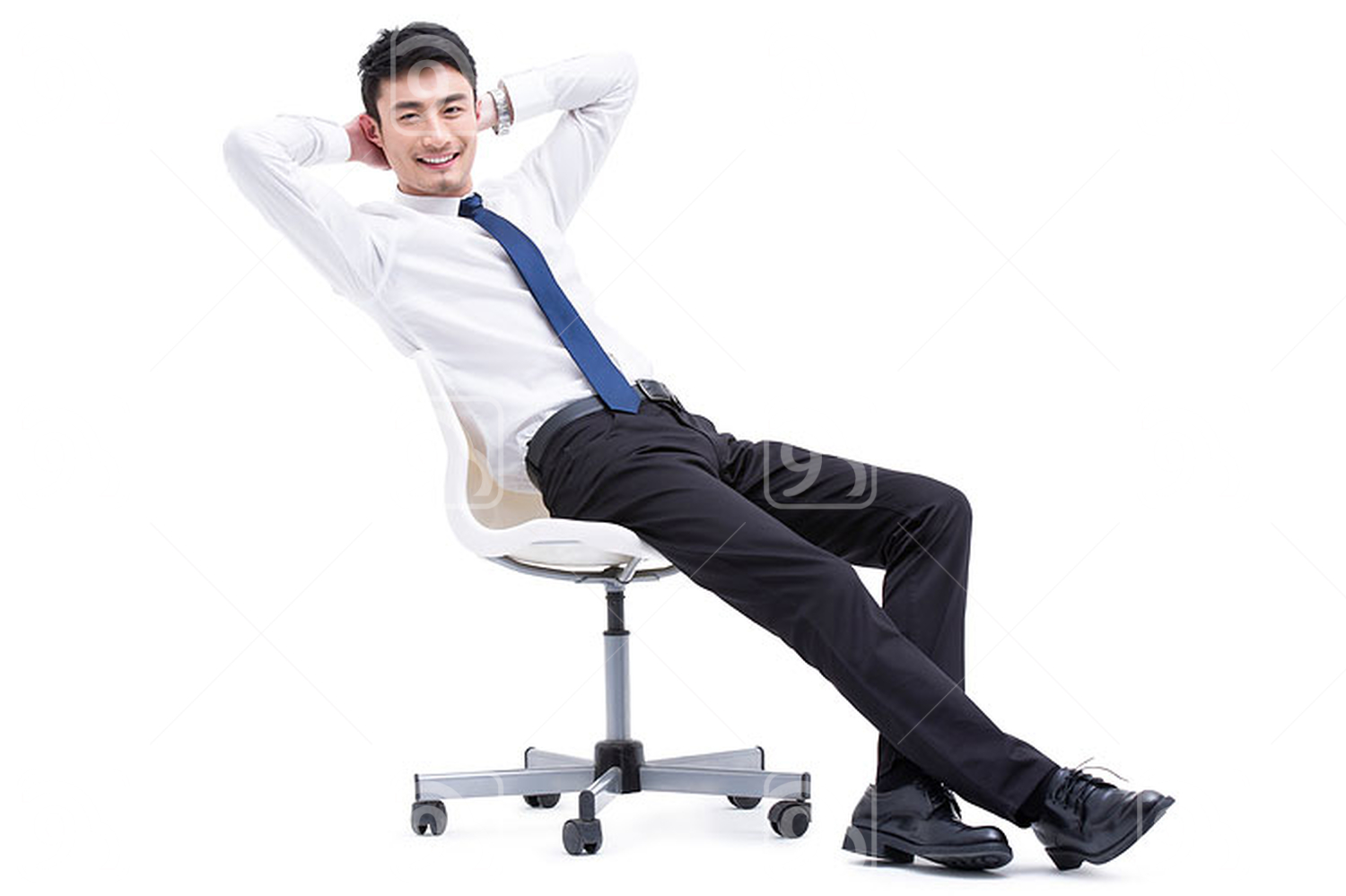 Young Chinese businessman relaxing with hands behind head