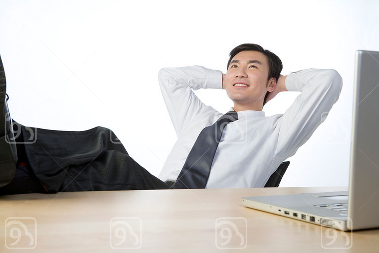 Chinese businessman relaxing in office