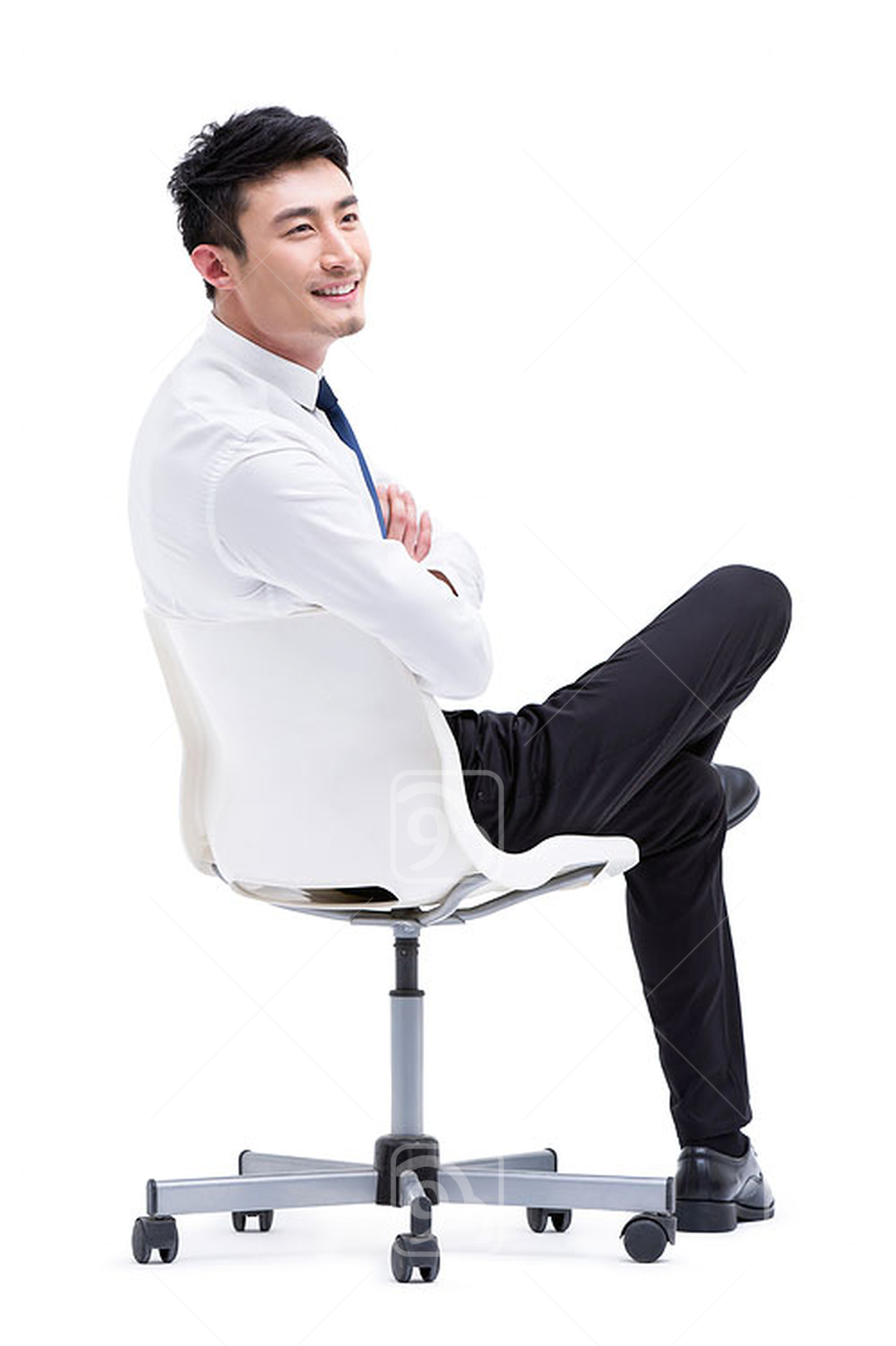 Confident young Chinese businessman sitting on chair