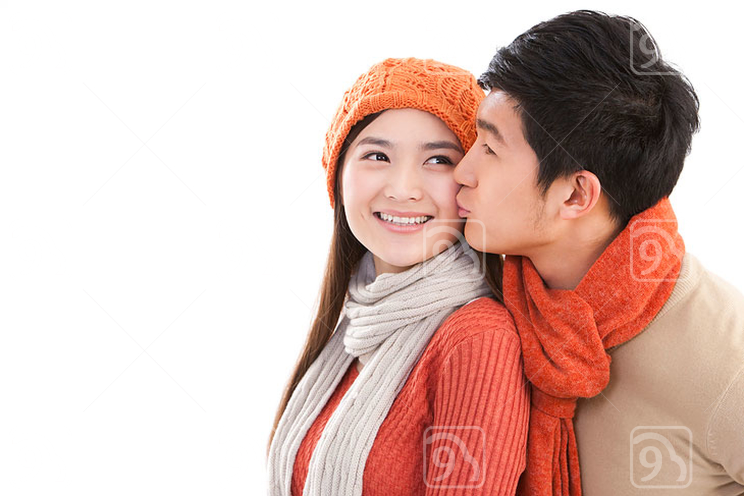 Young affectionate Chinese couple kissing
