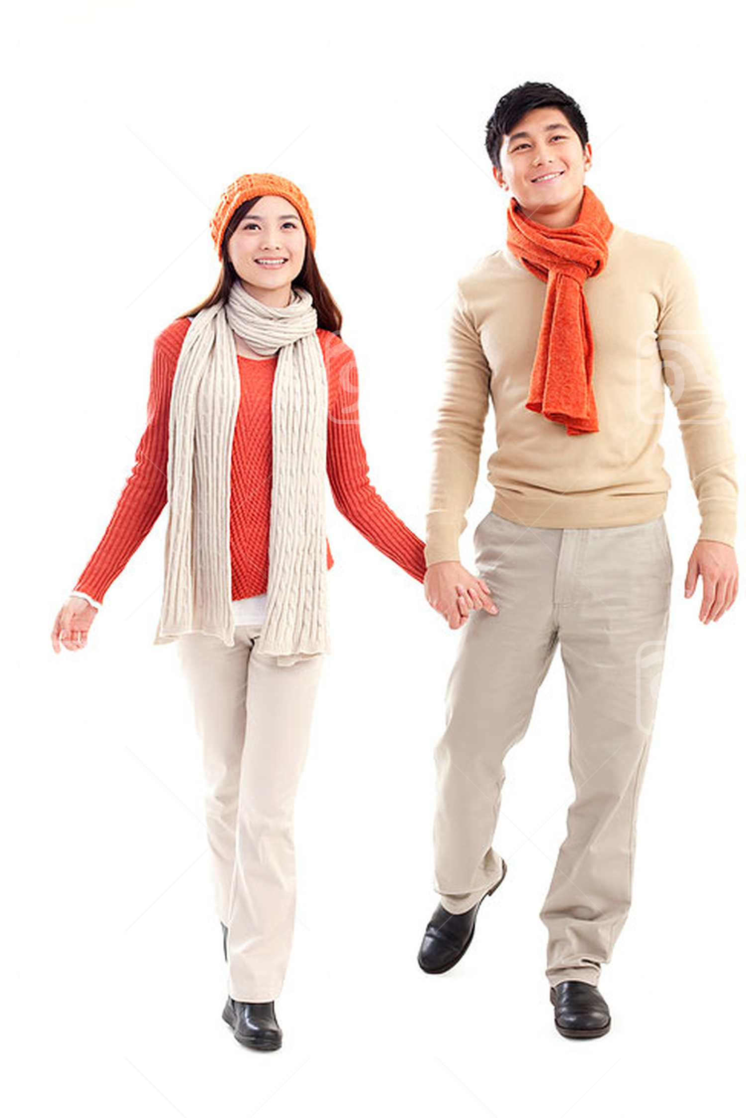Young affectionate Chinese couple walking