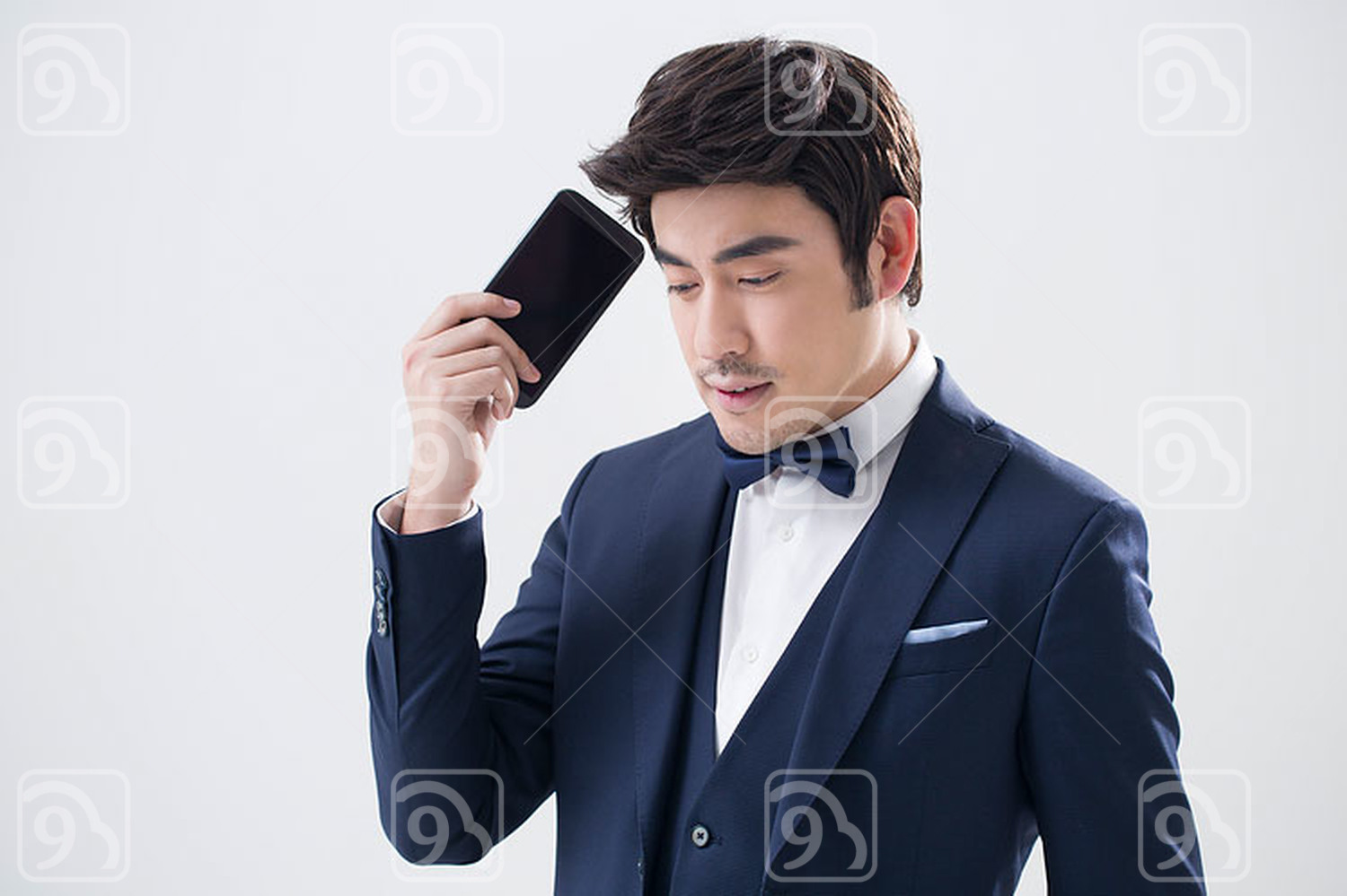 Young Chinese man holding a smart phone