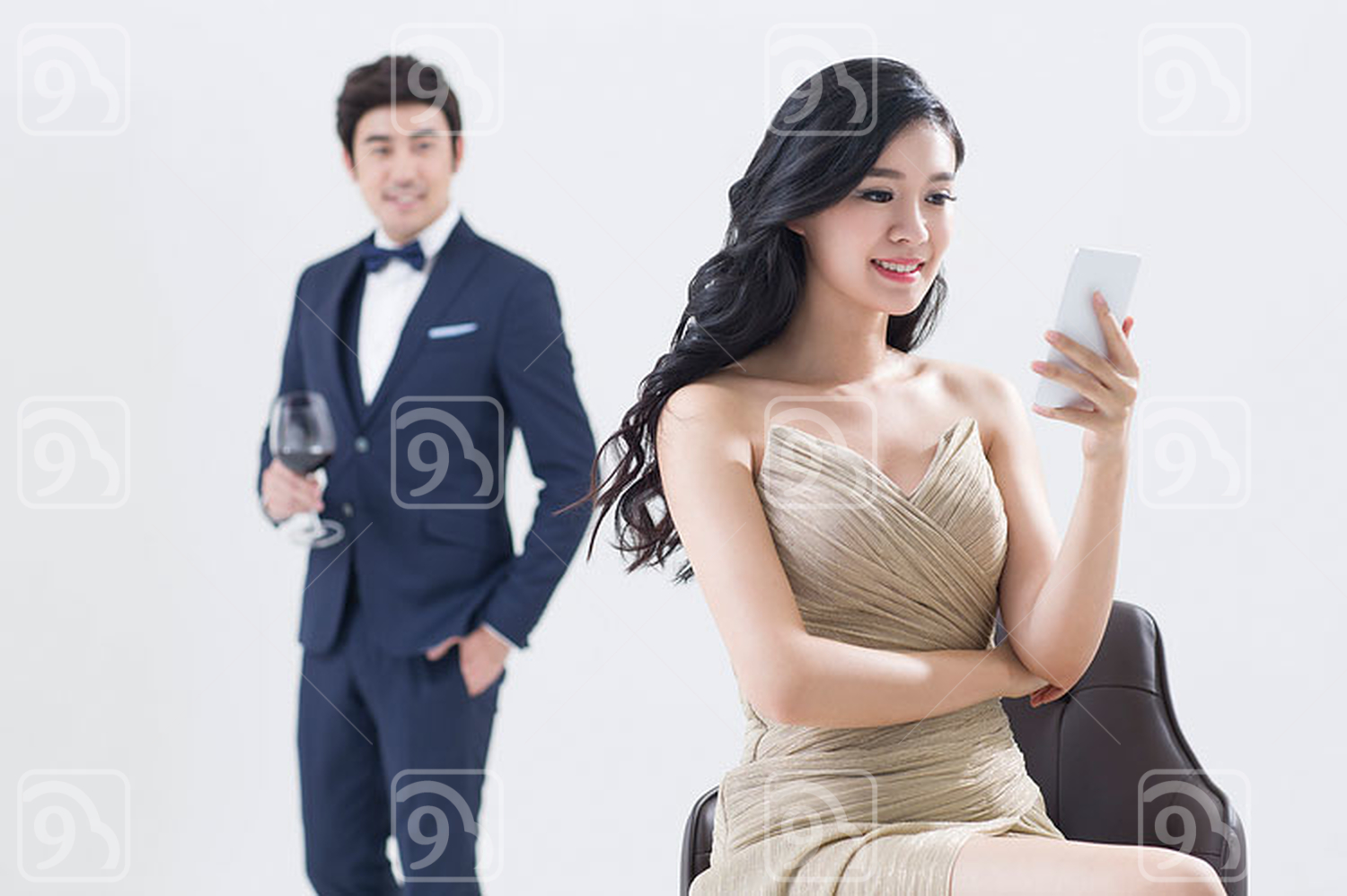 Elegant young Chinese woman using smart phone