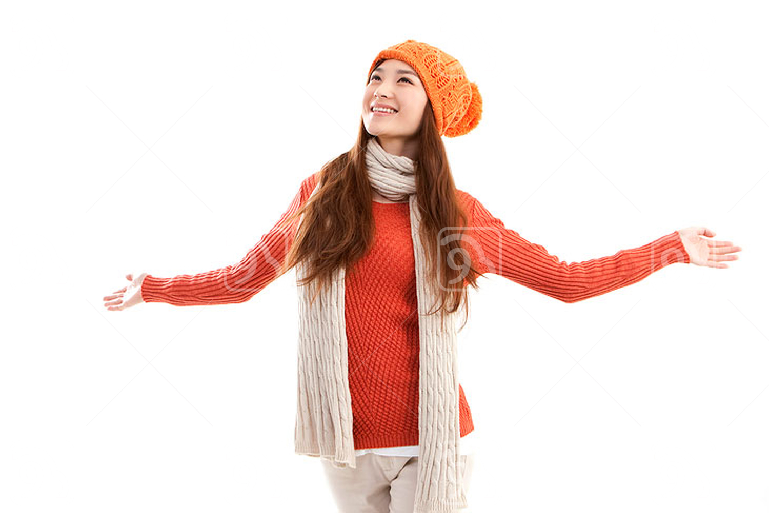 Young Chinese woman arms outstretched