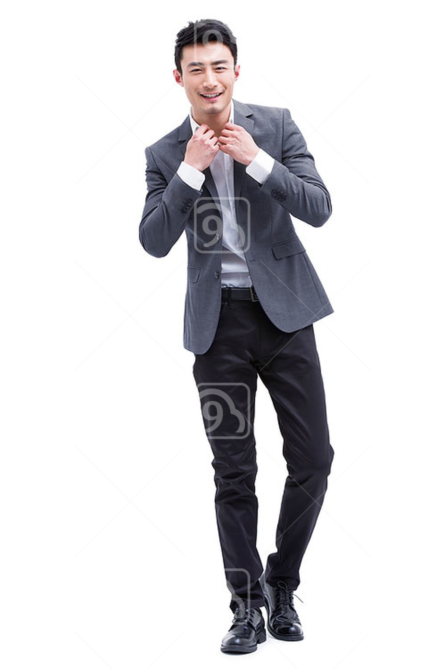 Fashionable Chinese businessman adjusting neckline