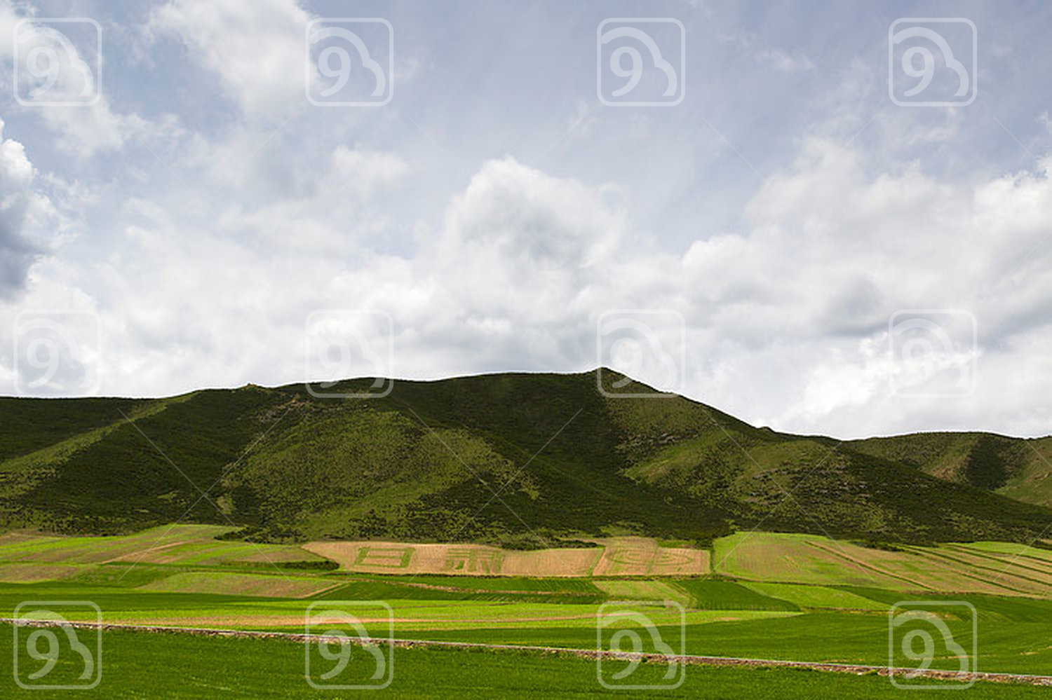 Mountain and field in Gansu province, China
