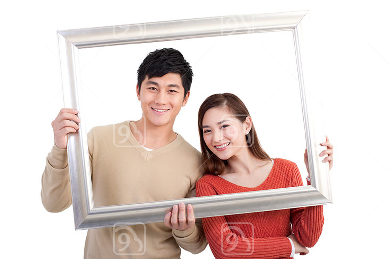 Happy Chinese young couple and picture frame