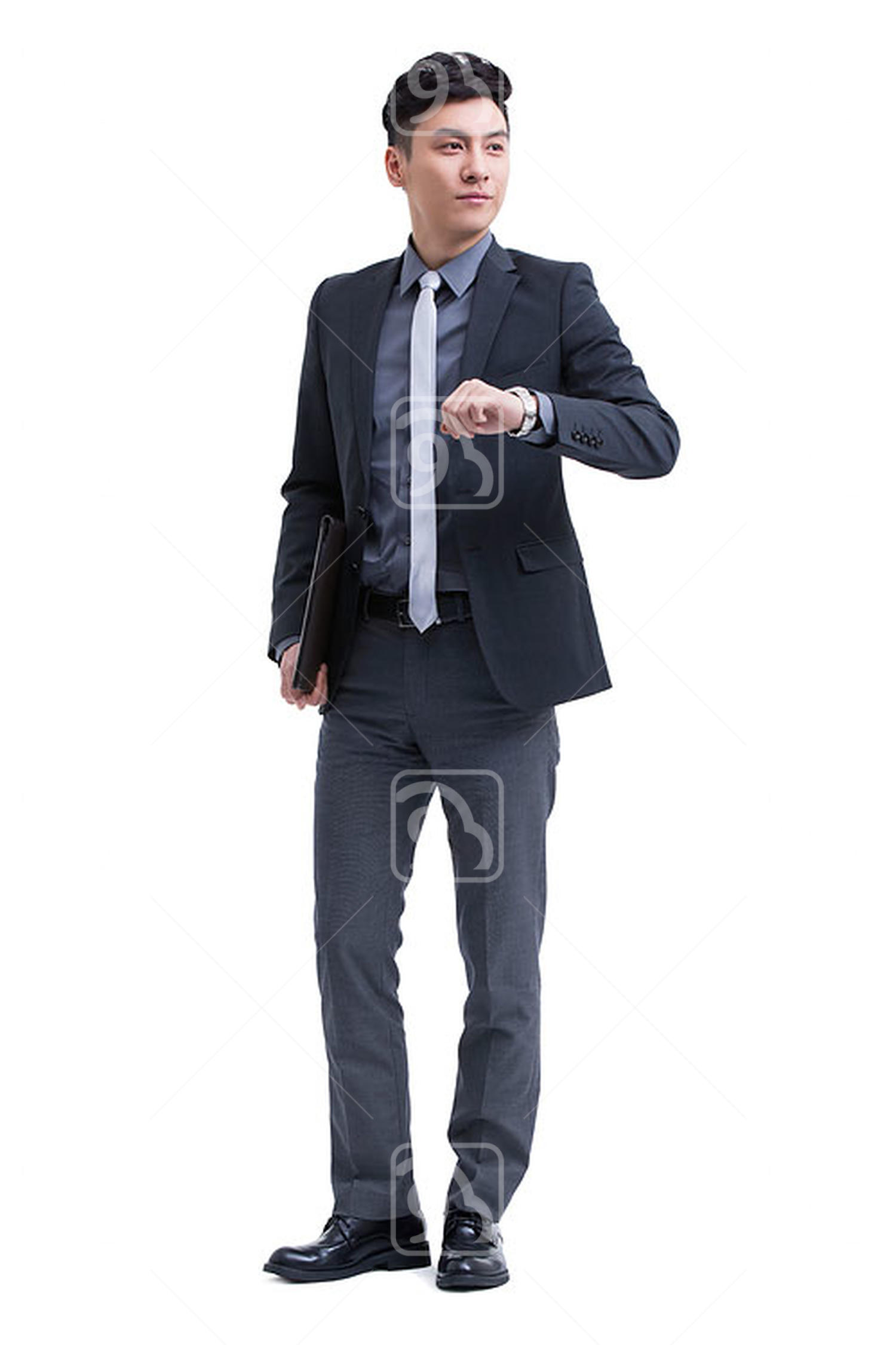 Chinese businessman checking the time on wristwatch