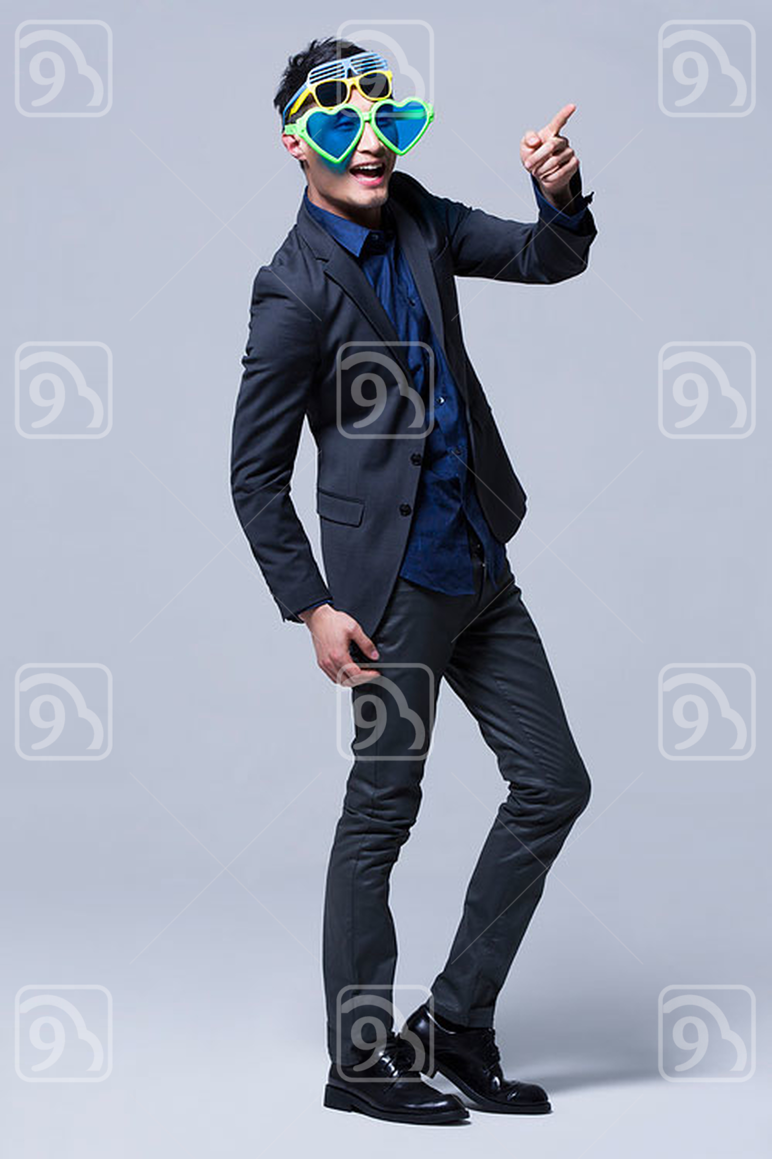 Hip young Chinese man wearing multiple pairs of sunglasses