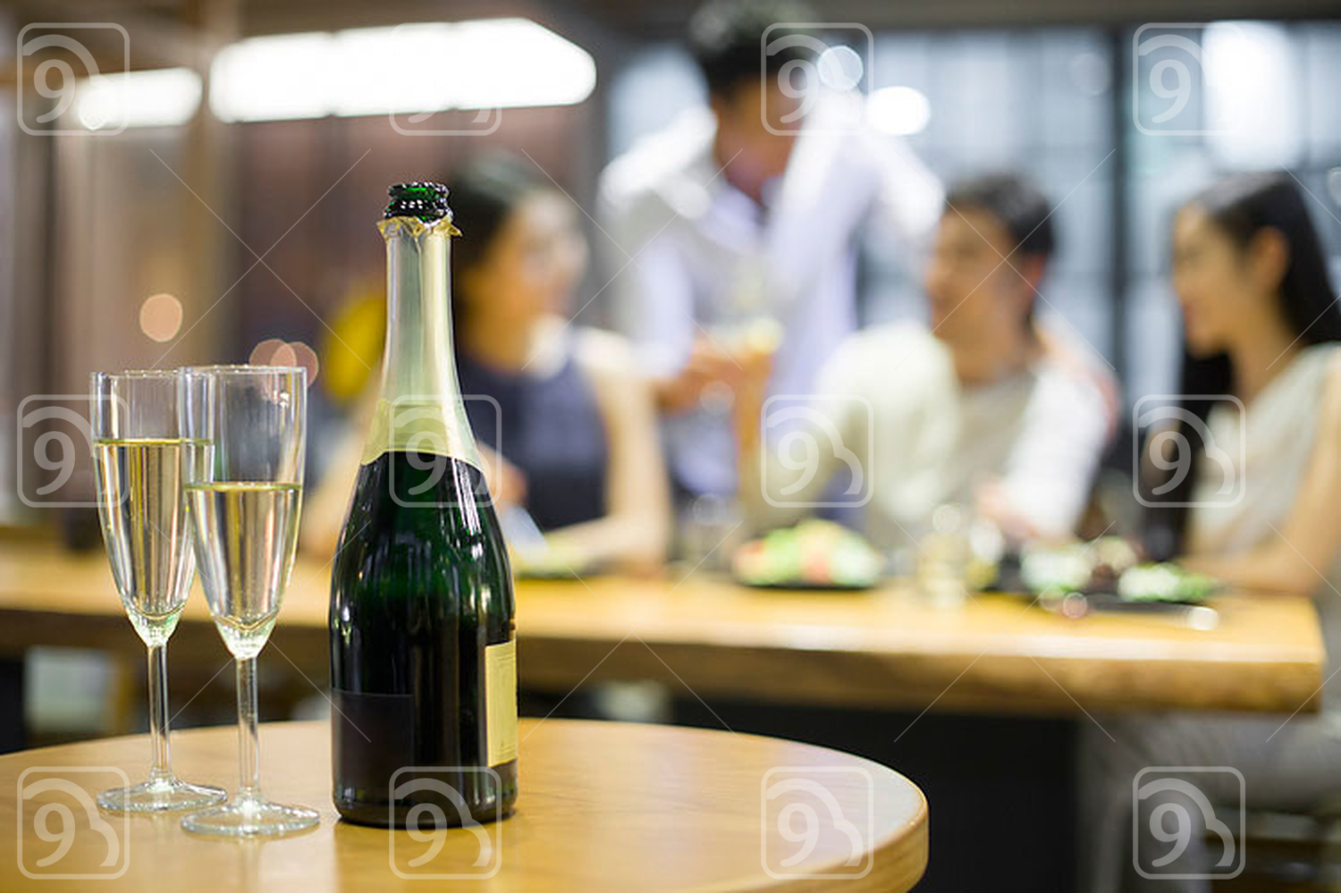 Close up of champagne with Chinese friends in background