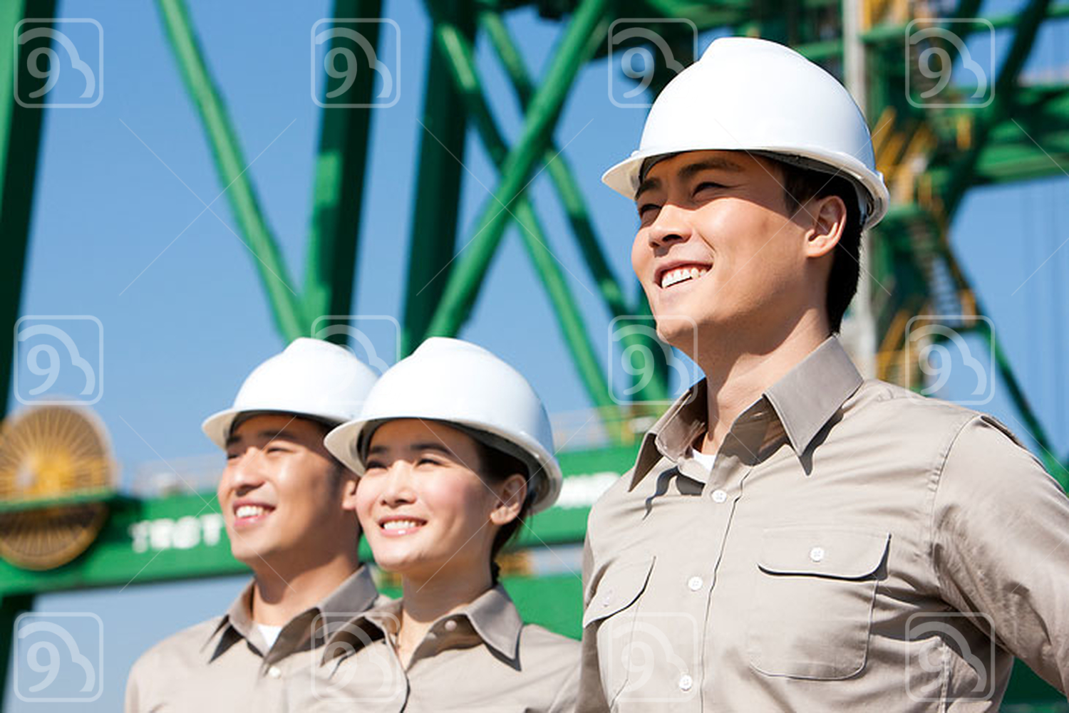 Chinese shipping industry workers looking in the distance