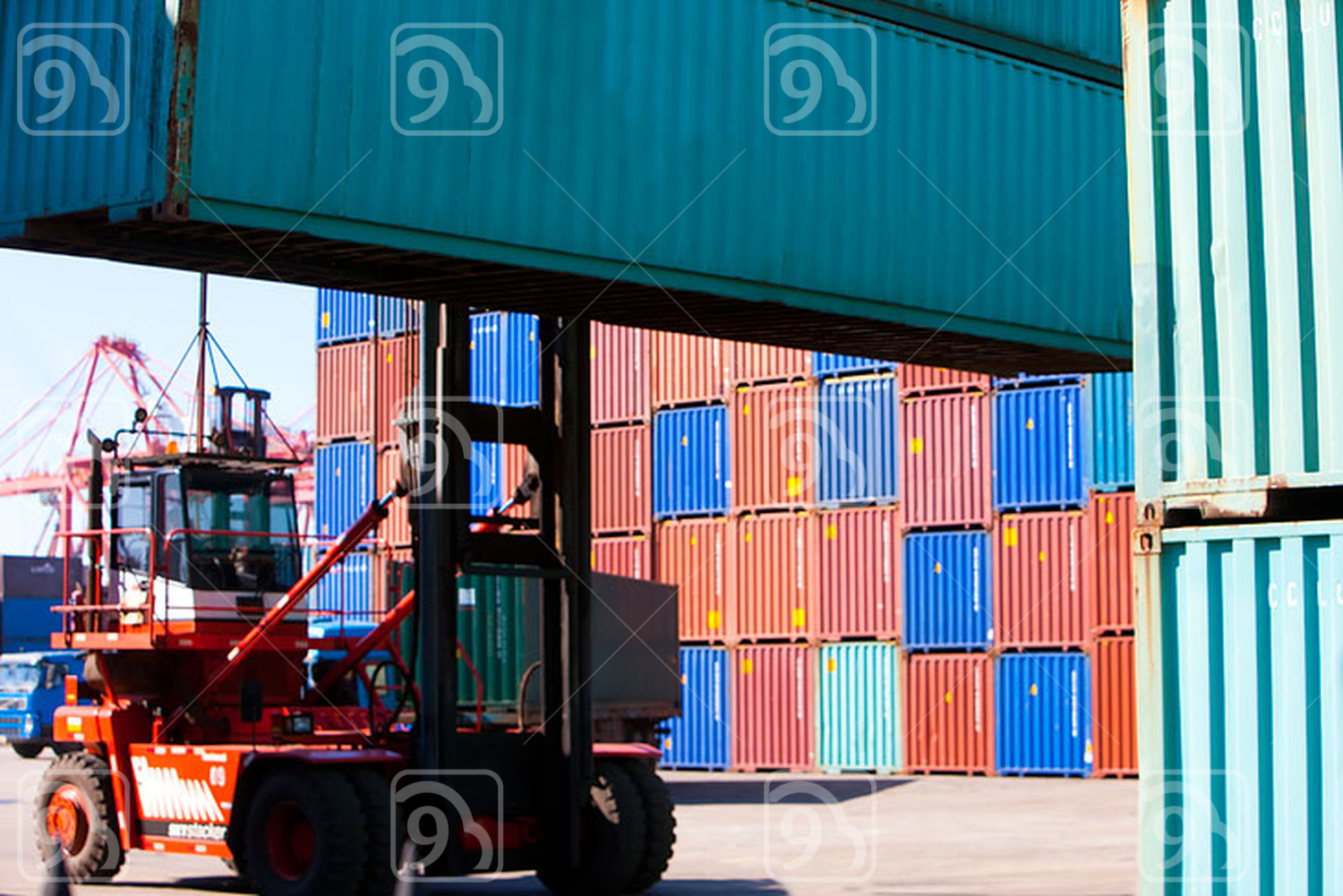 Truck lifting cargo containers