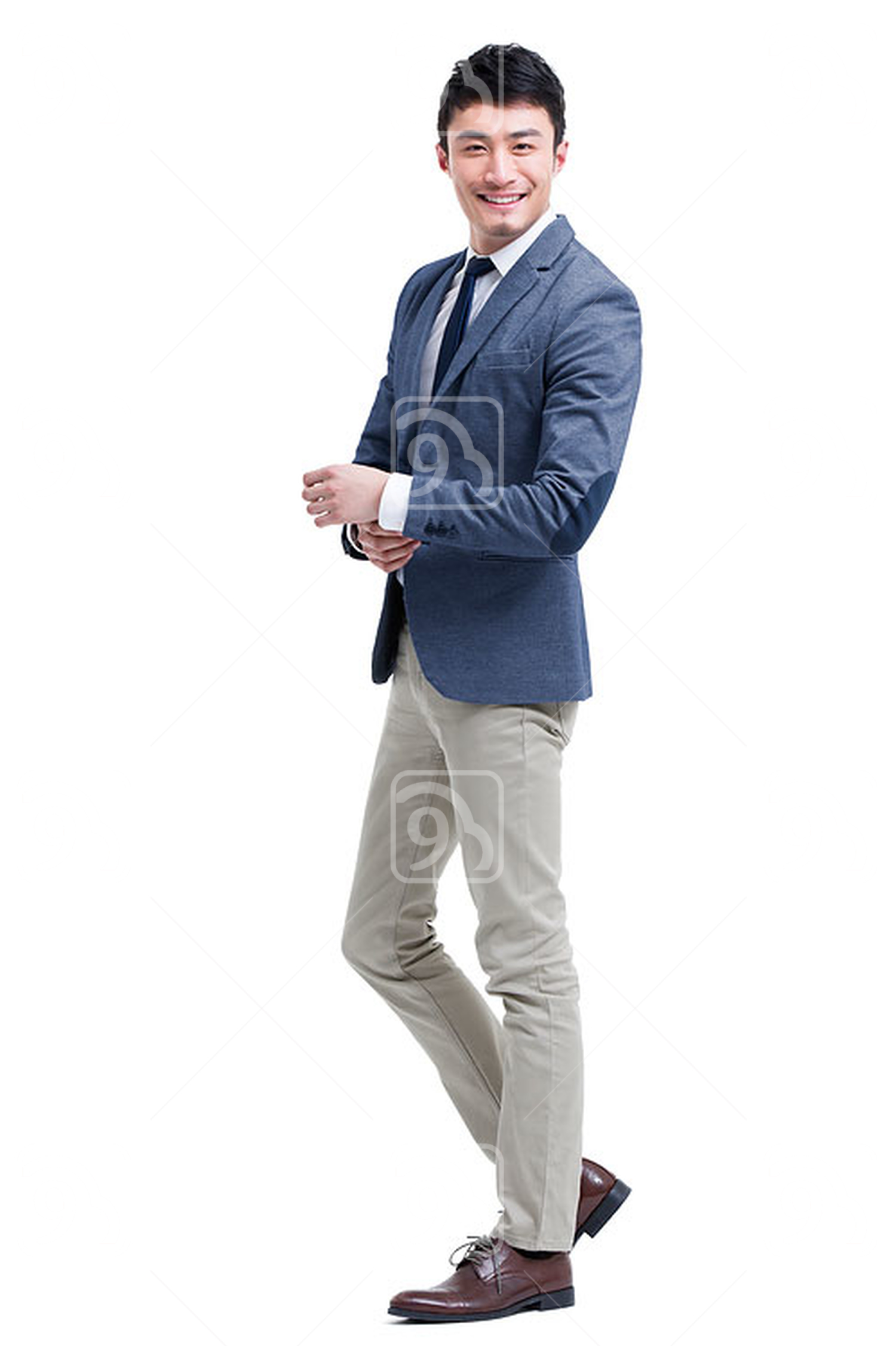 Fashionable Chinese businessman adjusting cuff