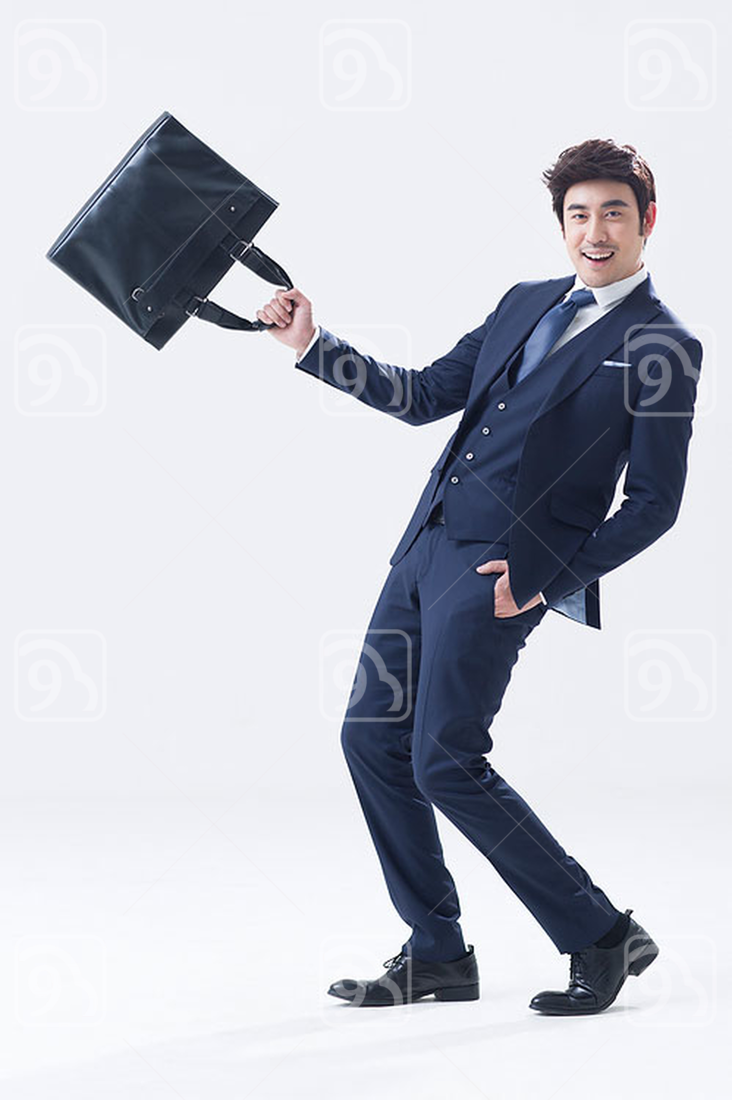 Happy young Chinese businessman with briefcase