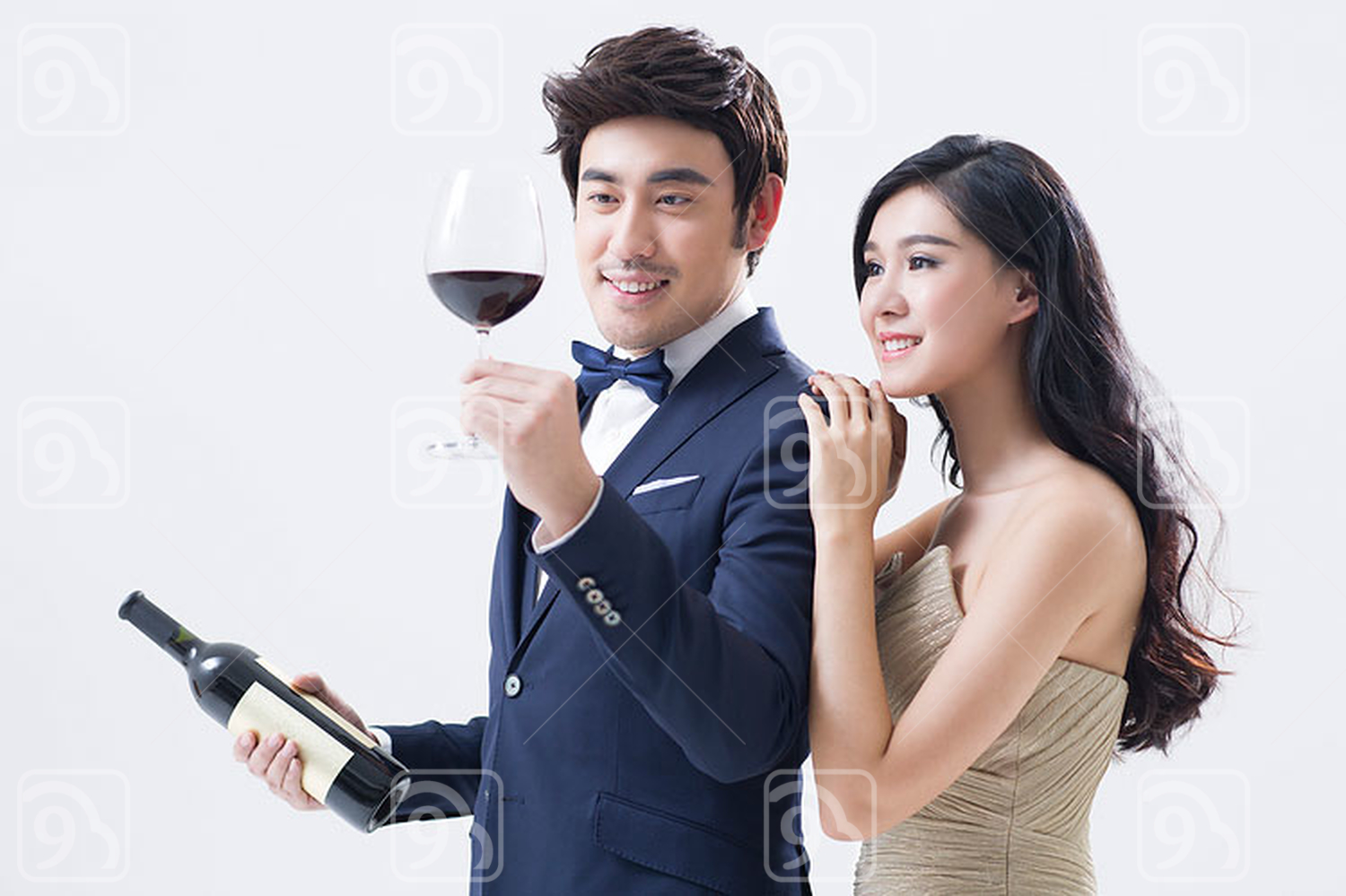 Elegant young Chinese couple enjoying red wine