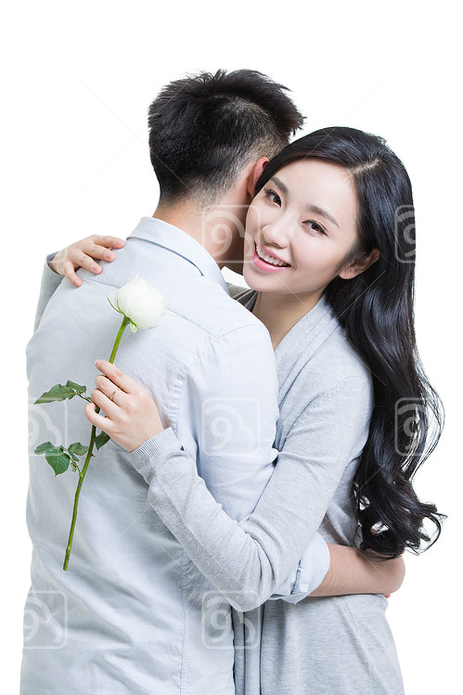 Young Chinese man giving a rose to girlfriend