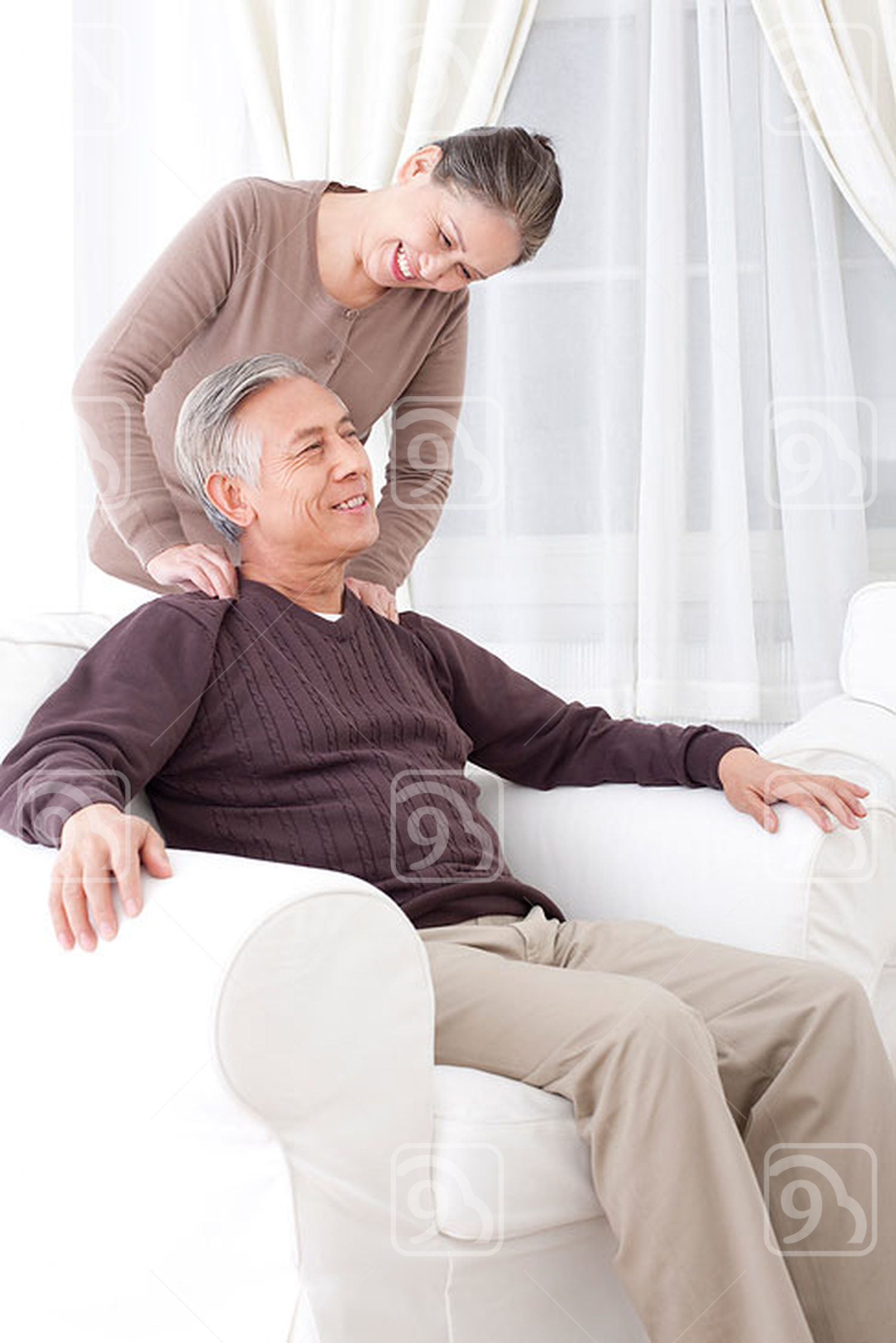 Happy Senior Chinese couple doing message