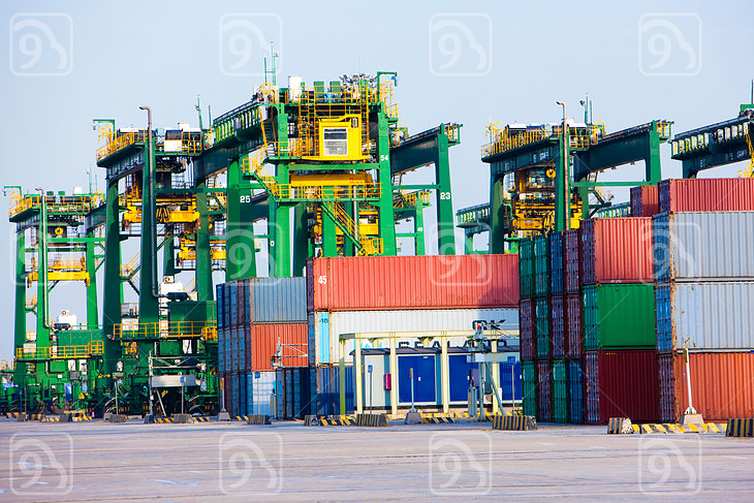 Cranes and cargo containers in shipping port