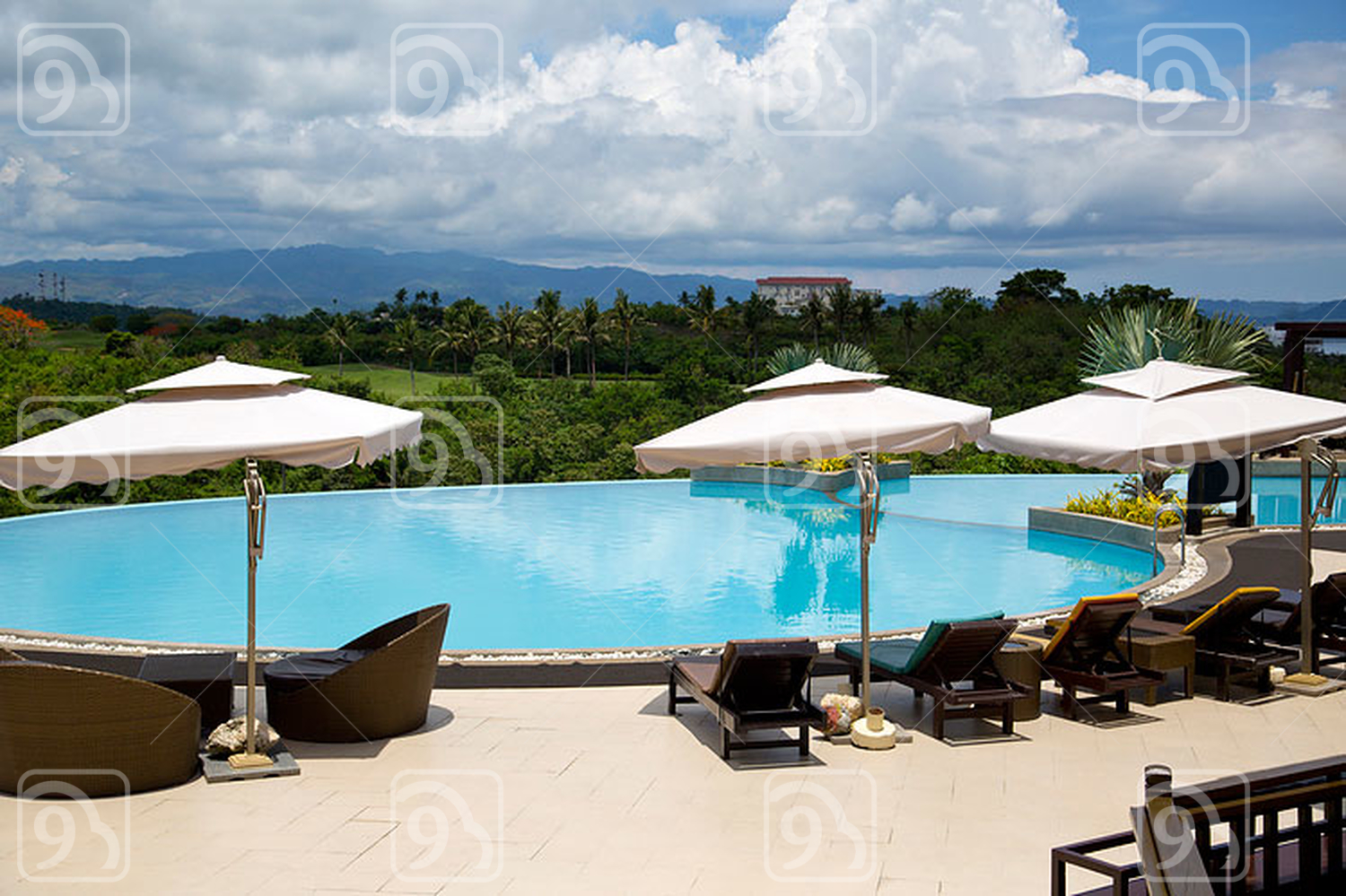 Swimming pool, lounge chairs and umbrellas