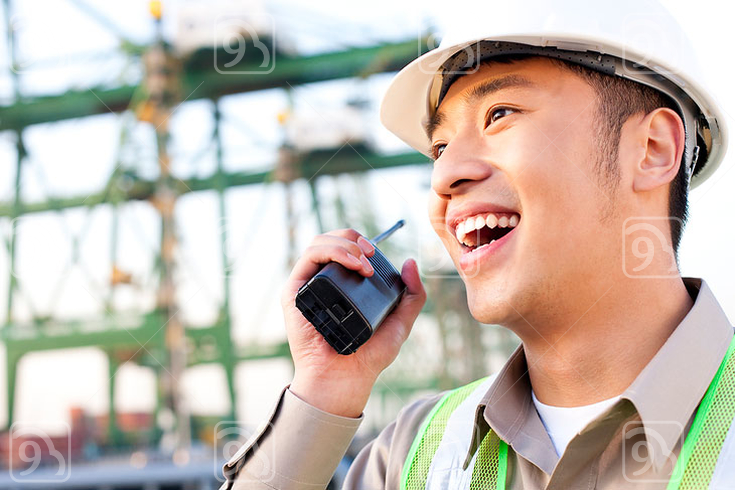 Chinese shipping industry worker using a walkie-talkie talking