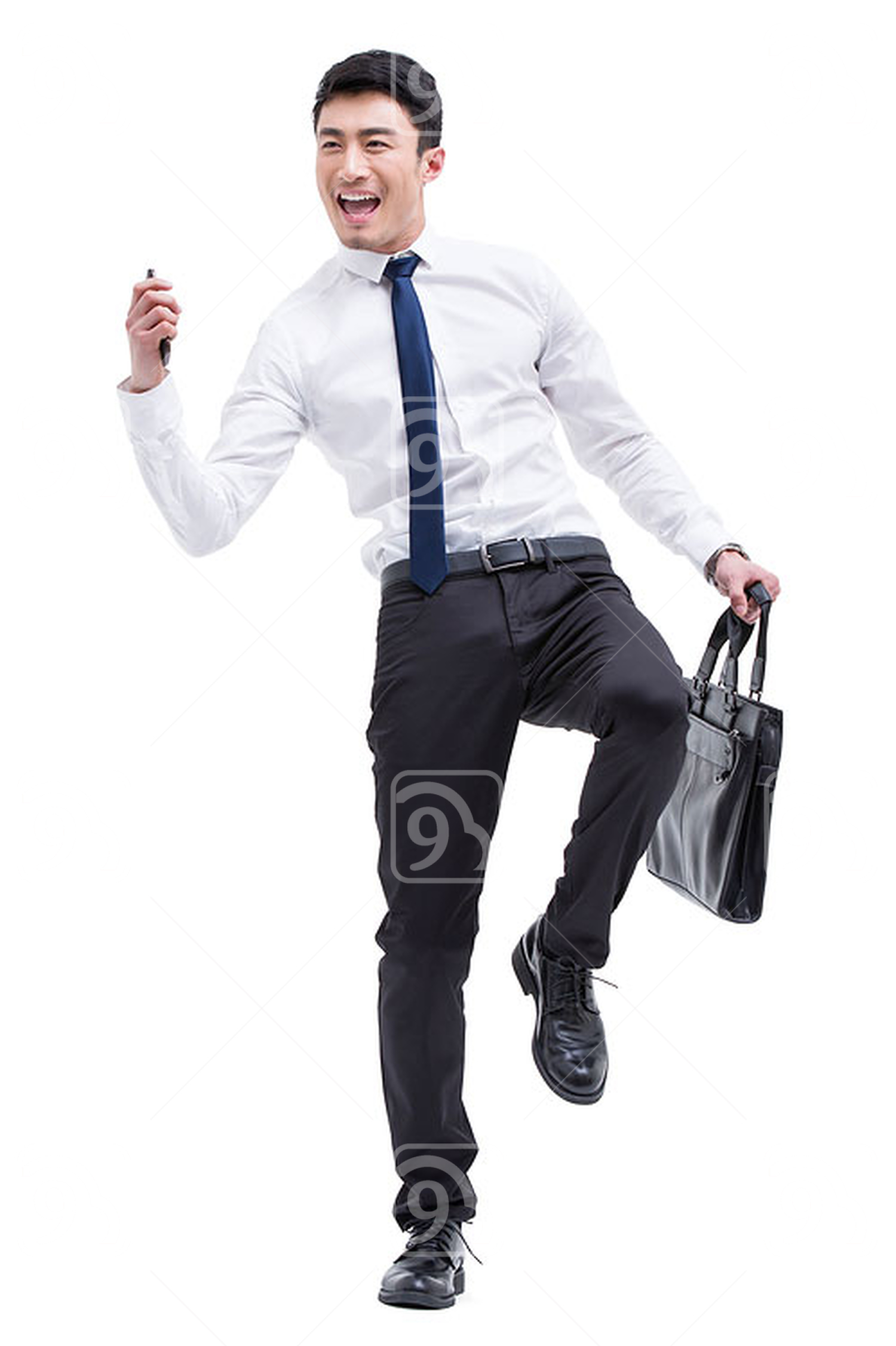 Fashionable Chinese businessman punching the air