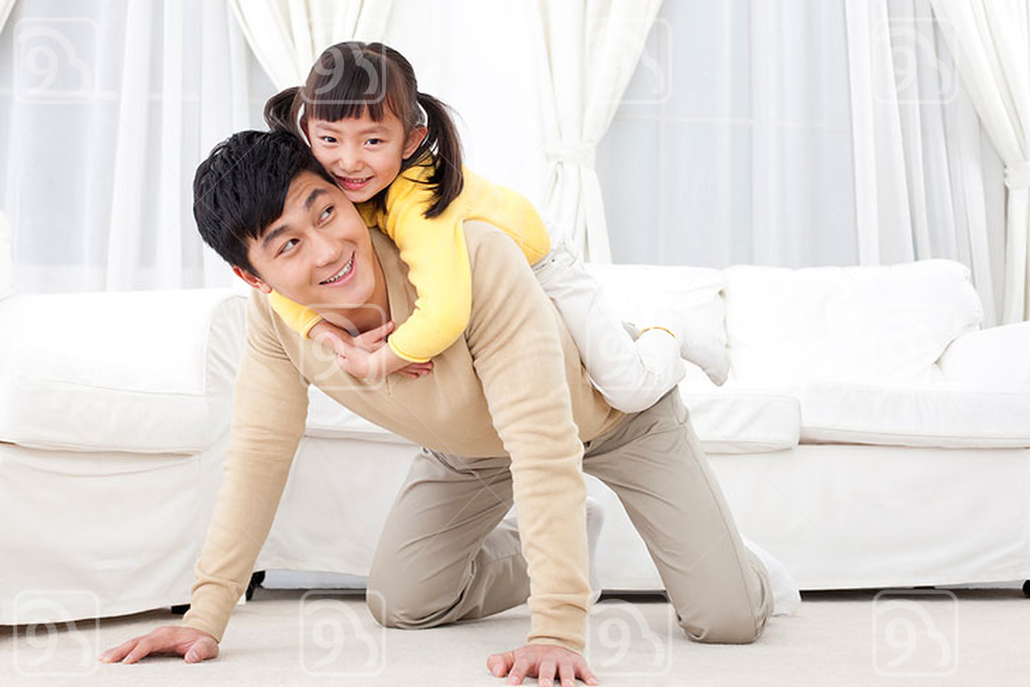 Chinese father playing with his daughter