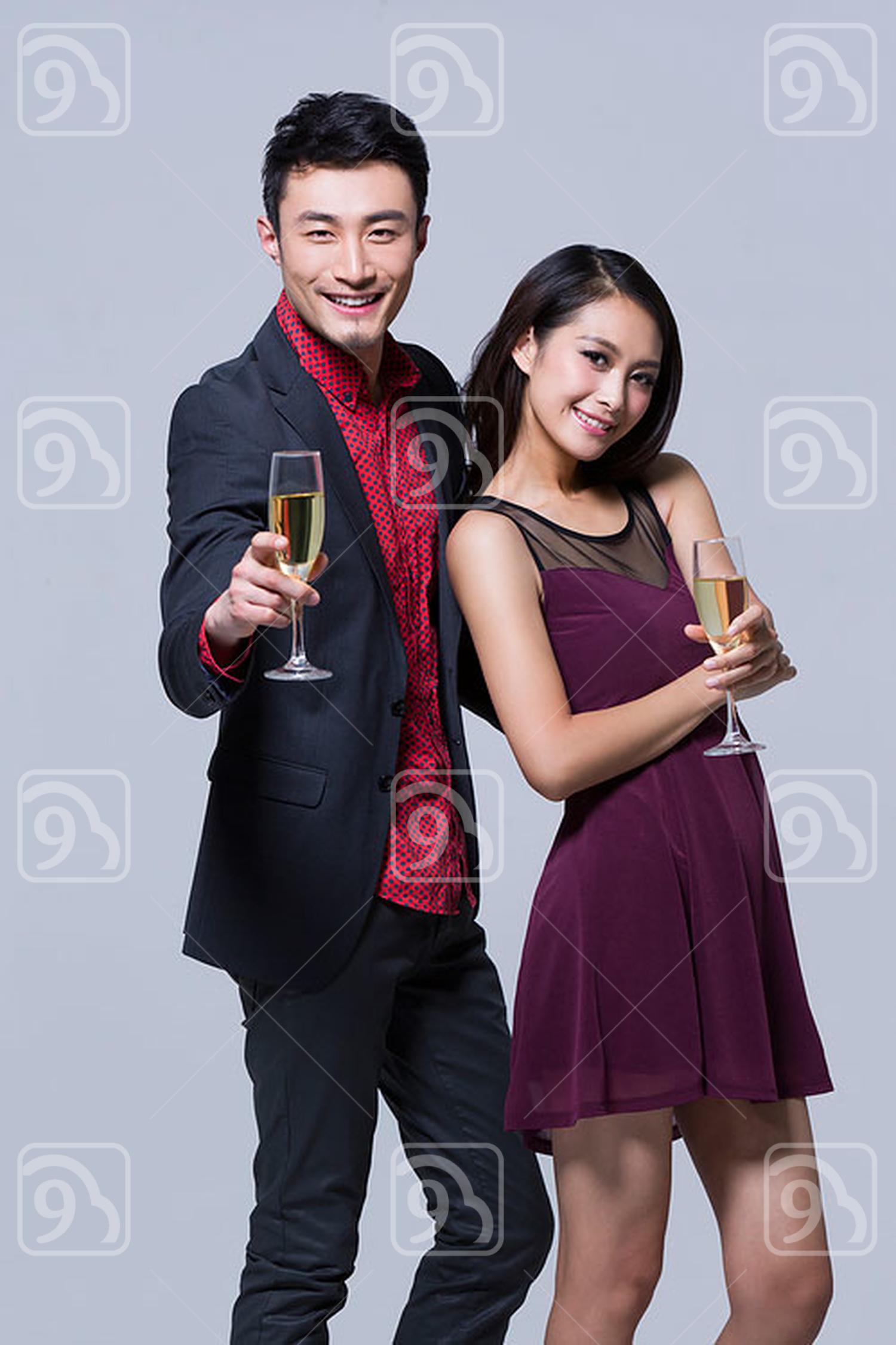 Happy young Chinese couple at a party